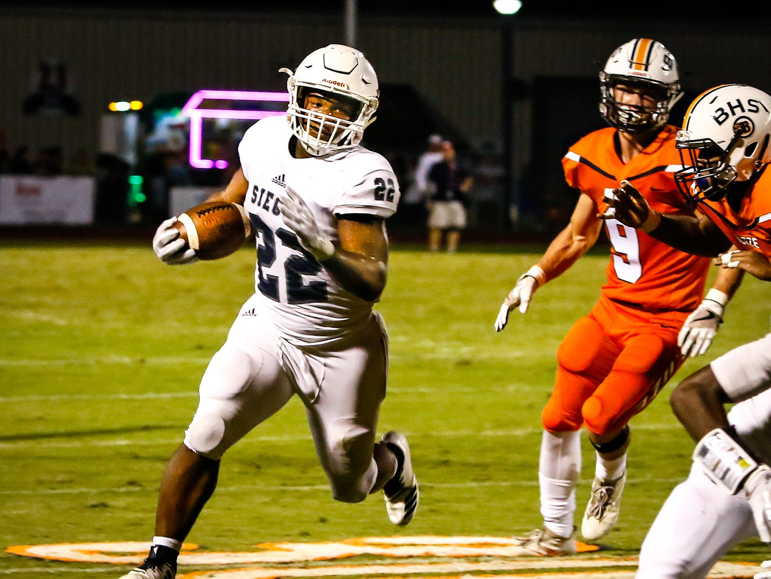 Siegel's Pat Boykins towards the sidelines for a big yardage play for Siegel.