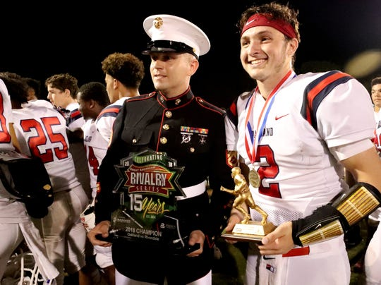 Oakland's Brevin Linnell (2) receives the MVP of the game trophy after beating Riverdale 49-6 during the Battle of the Boro on Friday, Sept. 14, 2018.