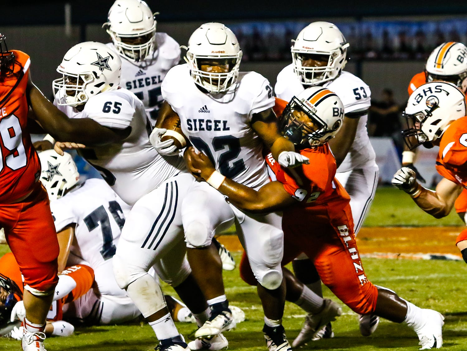 Siegel's Pat Boykins gains yardage as Blackman's Lorenzo Smith attempts a tackle.