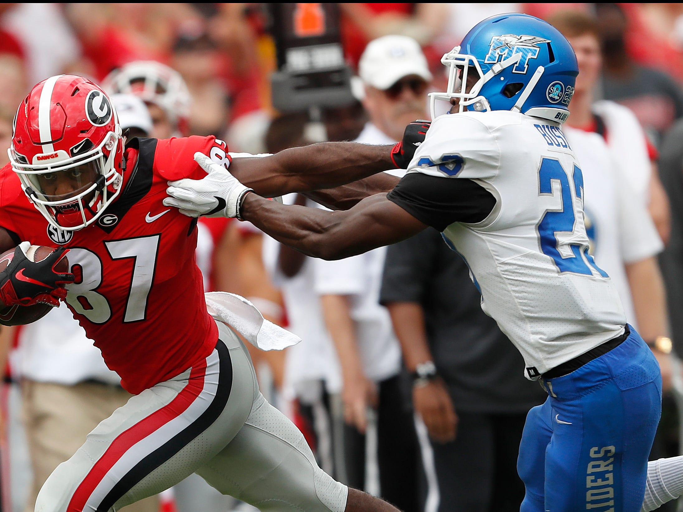 Georgia wide receiver Tyler Simmons (87) feeds off Middle Tennessee defensive back Wesley Bush (23) as he runs for a touchdown after a catch in the first half of an NCAA college football game Saturday, Sept. 15, 2018, in Athens, Ga. (AP Photo/John Bazemore)
