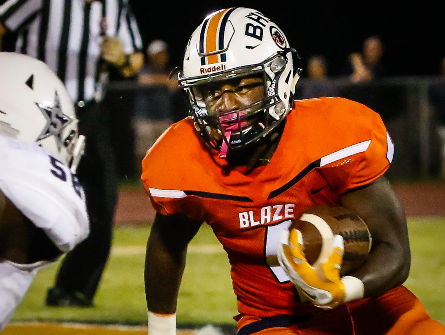 Blackman's Jordan Brown heads for a touchdown during Friday's 59-14 win over Siegel.