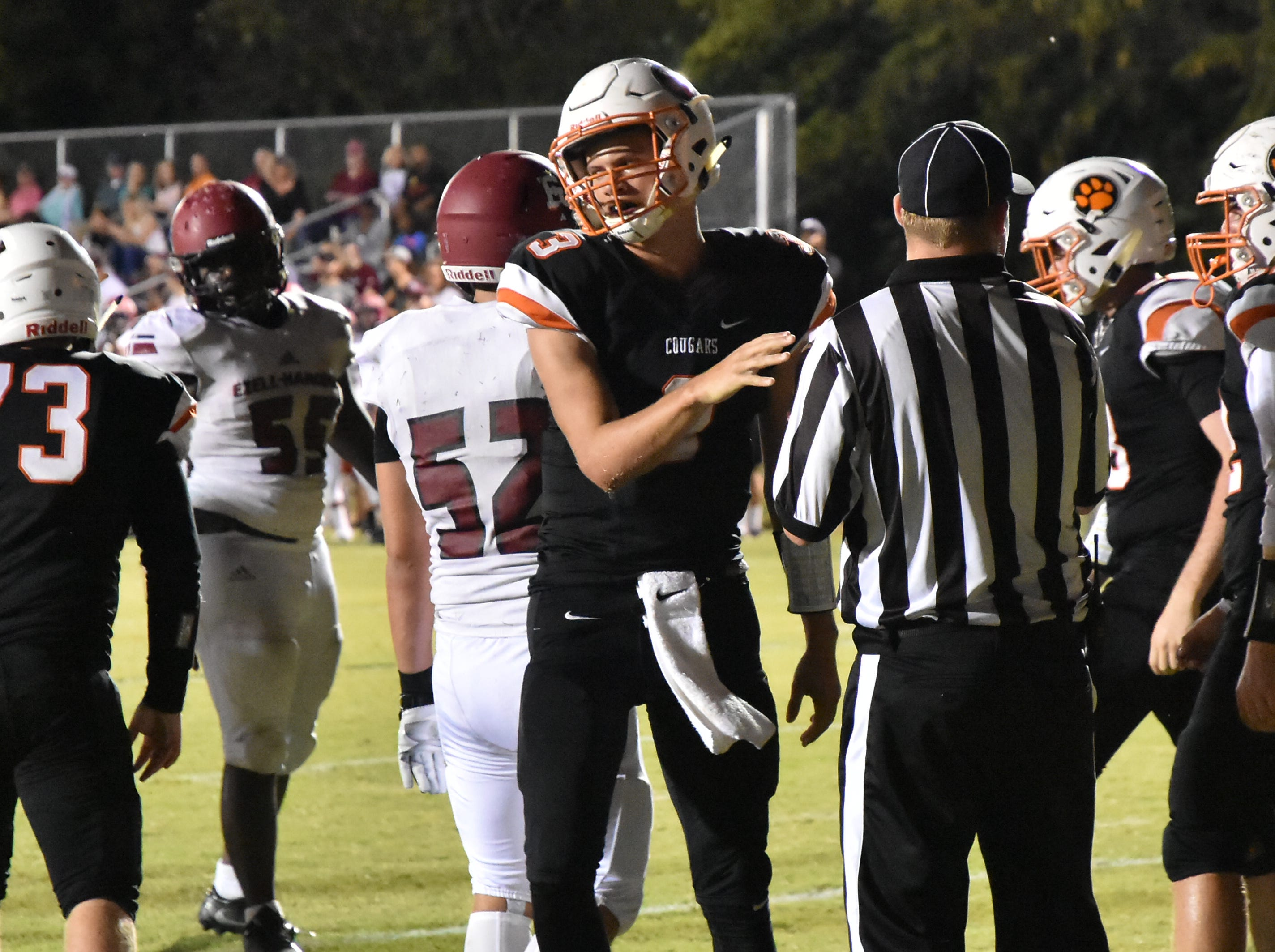 MTCS QB Jackson Green hands the ball to an official after rushing for a TD Friday night against Ezell-Harding.