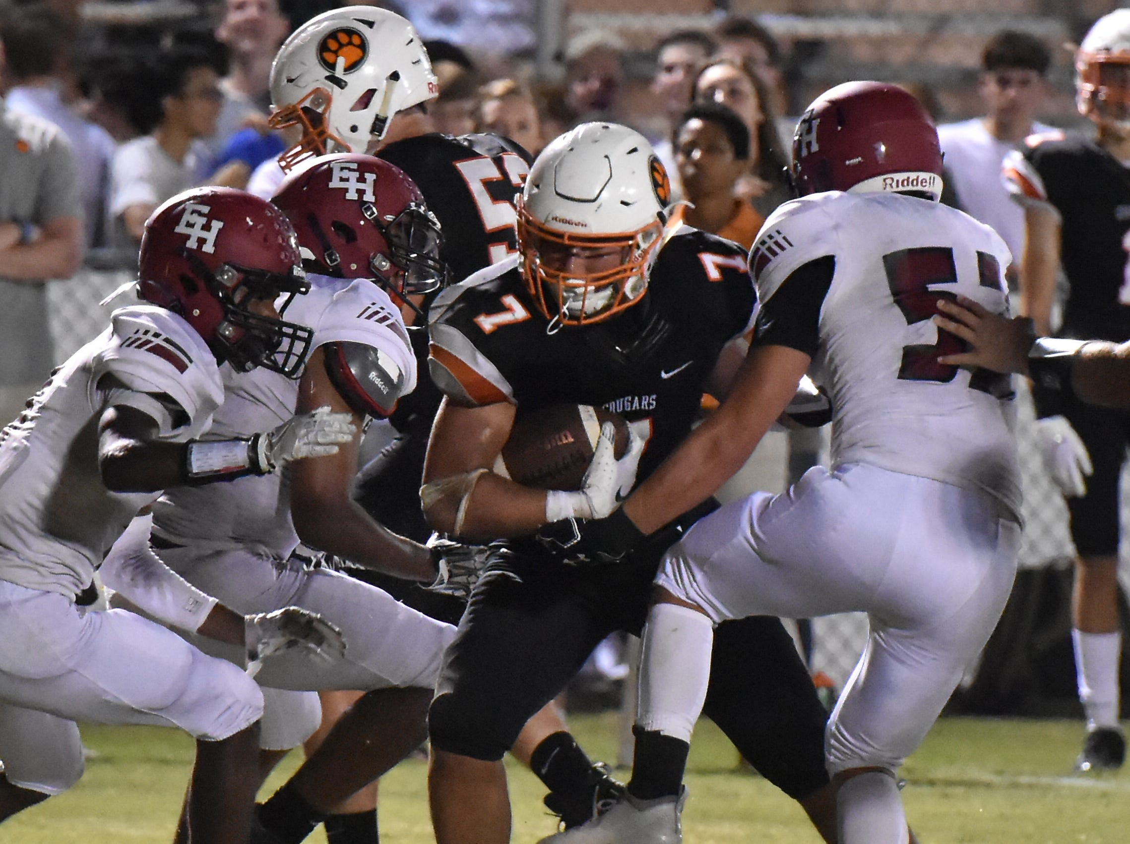 Drew Berry, grandson of NFL legend Raymond Berry, is tackled after a reception Friday night against Ezell-Harding.