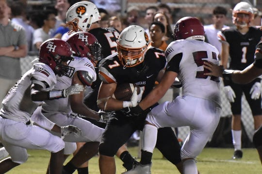 Drew Berry is tackled after a reception Friday night against Ezell-Harding.