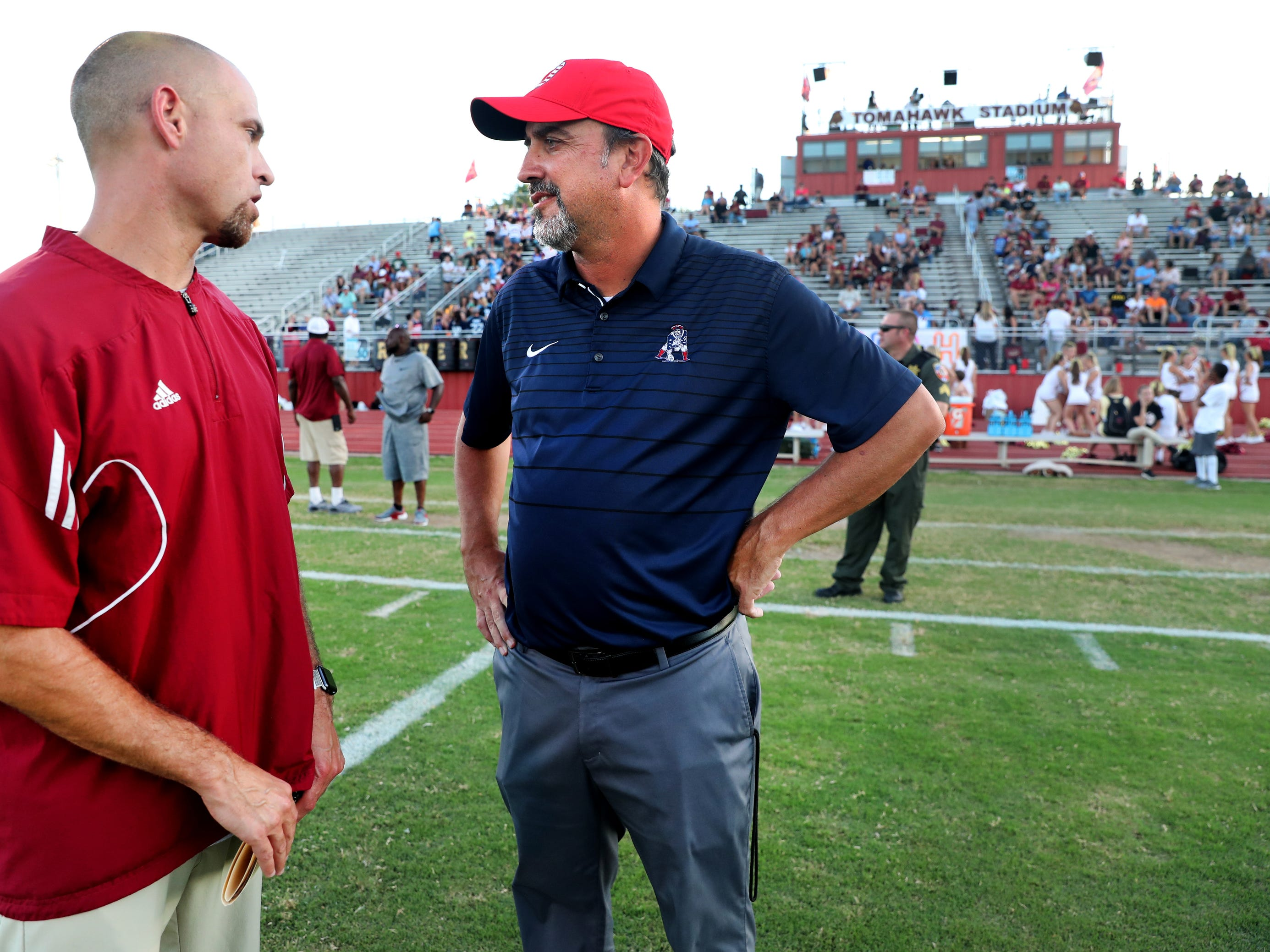 Riverdale's head football coach Will Kriesky, left and Oakland's head football coach Kevin Creasy before the game between Oakland and Riverdale, during the Battle of the Boro, on Friday, Sept. 14, 2018, at Riverdale.