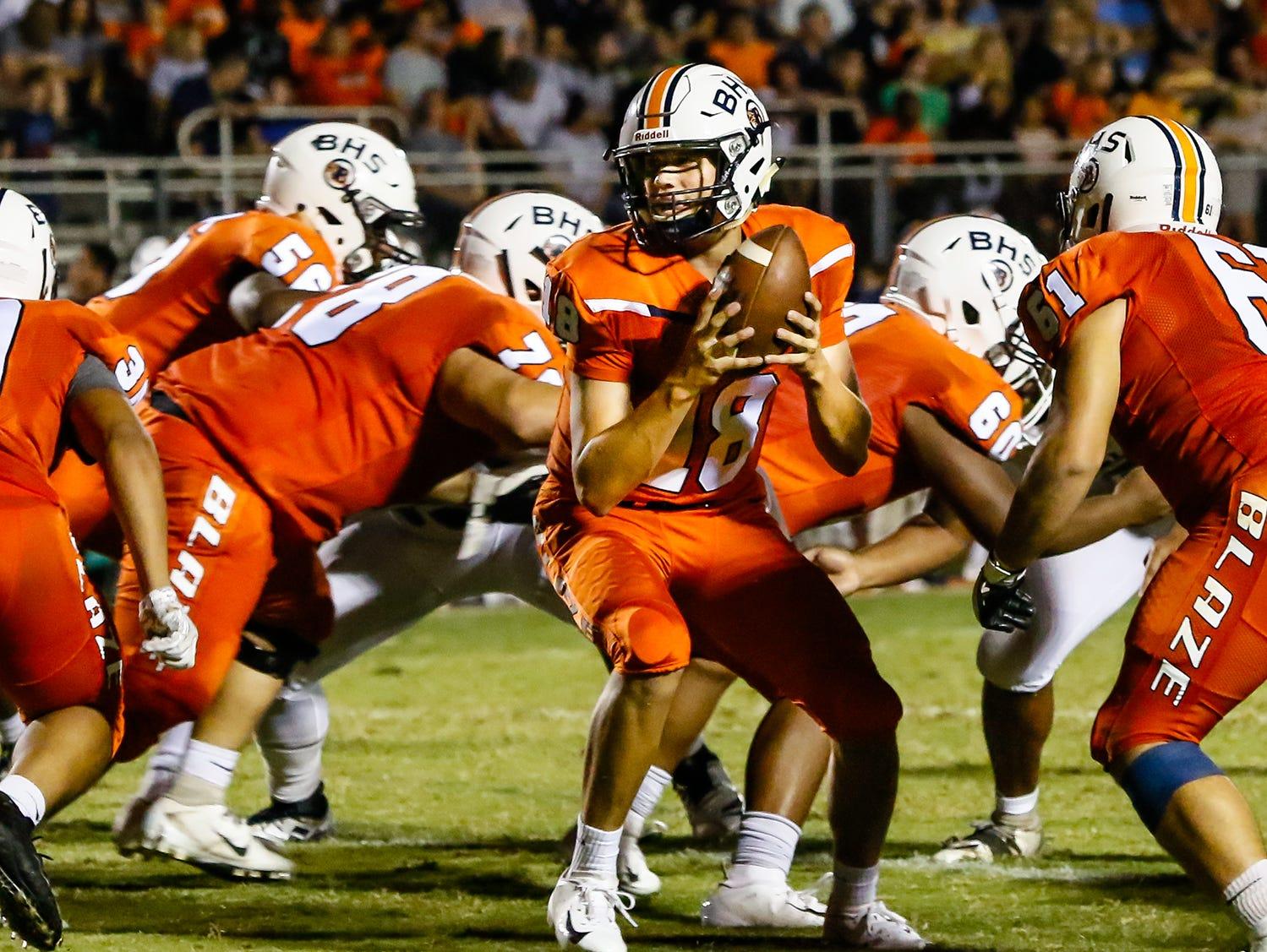 Blackman quarterback Drew Beam prepares for a handoff.