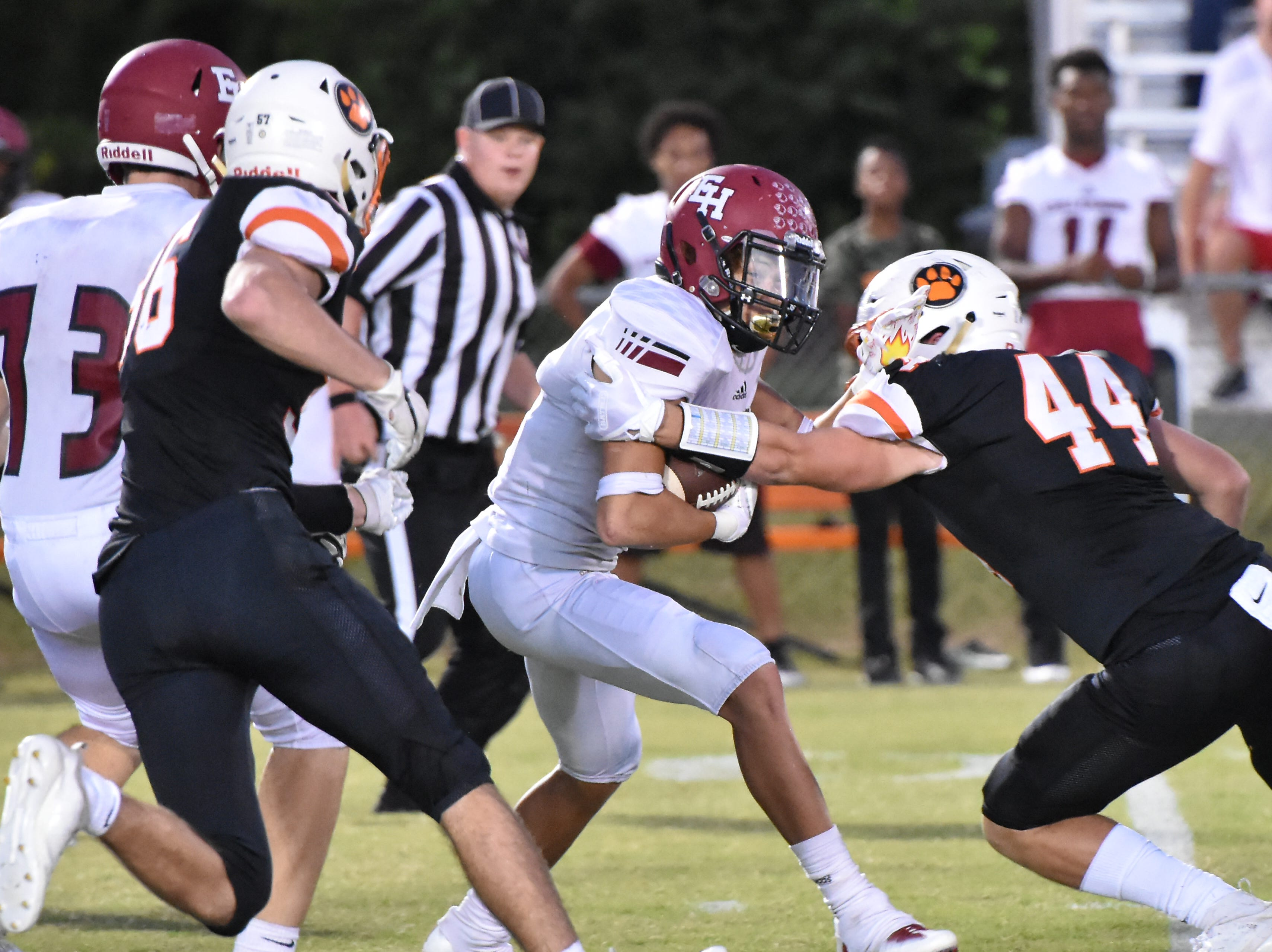 Ezell-Harding halfback Braxton Coleman prepares to be tackled by MTCS's Trey Harris Friday night.
