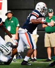 Virginia running back Jordan Ellis (1) powers past an Ohio defender to score a touchdown during the second quarter at Vanderbilt Stadium Saturday, Sept. 15, 2018, in Nashville, Tenn.