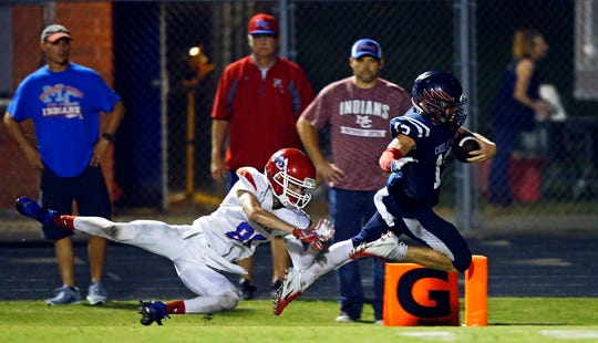 Creek Wood's Sam Askins (13) dives into the end zone as Montgomery Central's Justin Straw tries to stop him during their game Friday, Sept. 14, 2018, in Charlotte, Tenn.