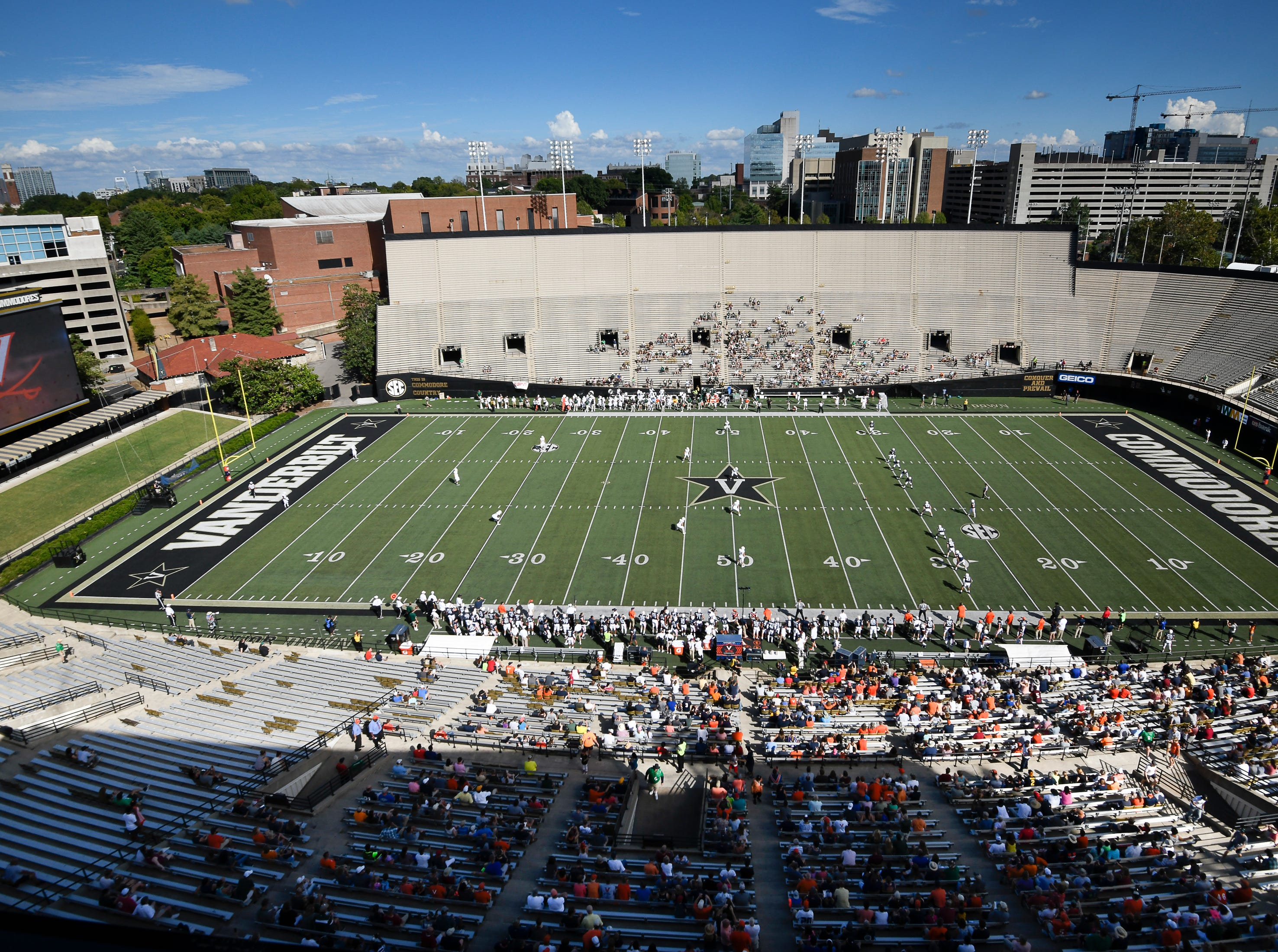 Virginia and Ohio fans file into Vanderbilt Stadium to watch their teams play Saturday, Sept. 15, 2018, in Nashville, Tenn. Their football game was moved from Virginia to Tennessee to avoid the effects of Hurricane Florence.