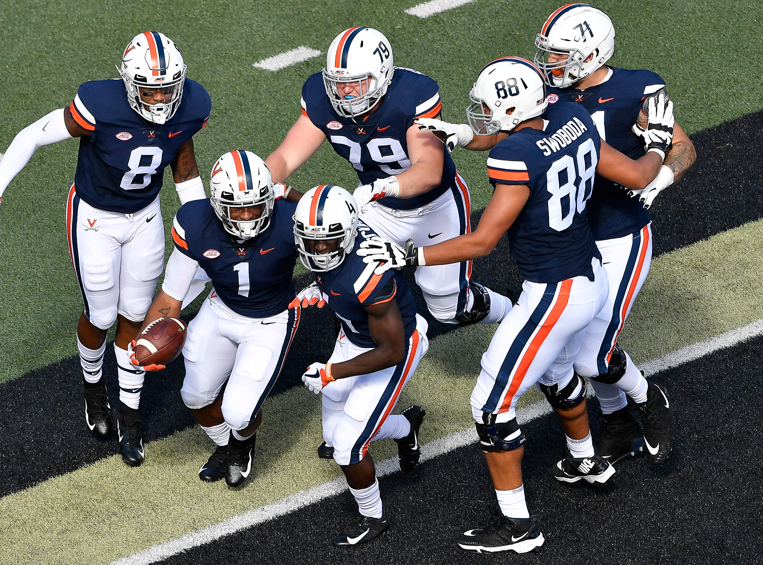 Virginia teammates congratulate Virginia running back Jordan Ellis (1) after his touchdown against Ohio during the first quarter at Vanderbilt Stadium Saturday, Sept. 15, 2018, in Nashville, Tenn.