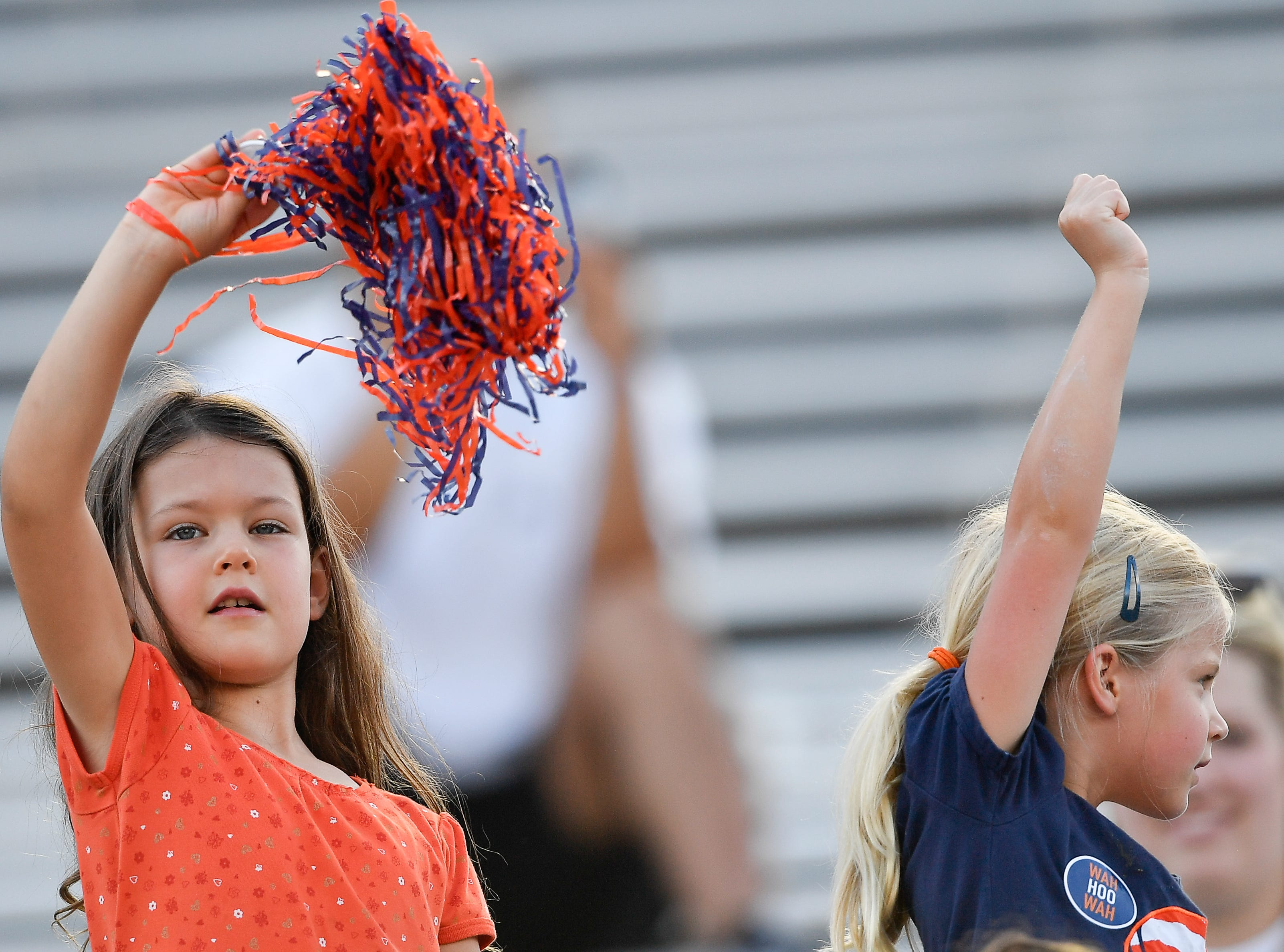 Virginia fans cheer for their Cavaliers as they against Ohio Saturday, Sept. 15, 2018, in Nashville, Tenn. Their football game was moved from Virginia to Tennessee to avoid the effects of Hurricane Florence.
