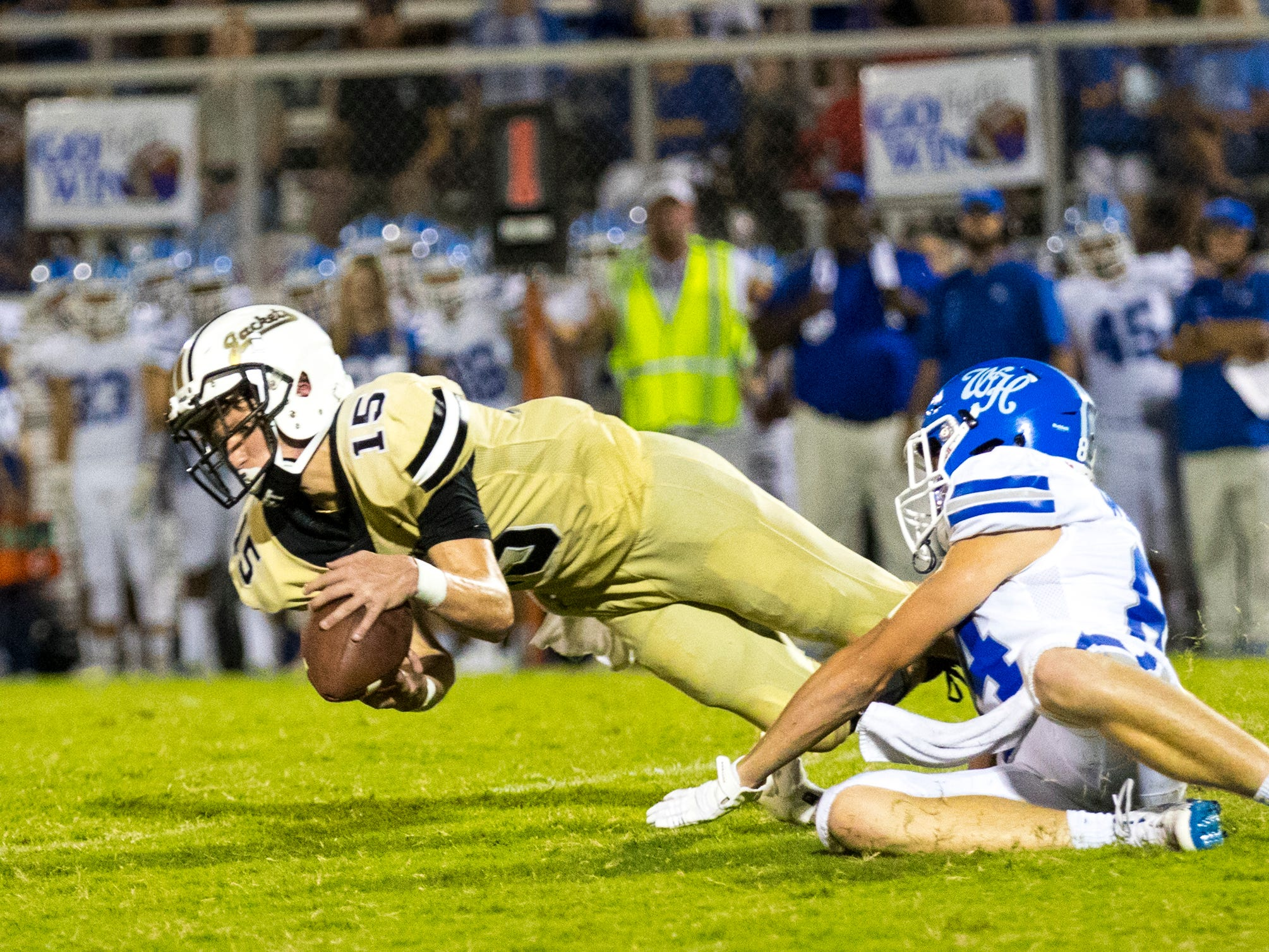 Springfield's Cale Jones (15) dives for an interception during Springfield's game against White House at Springfield High School in Springfield on Friday, Sept. 14, 2018.