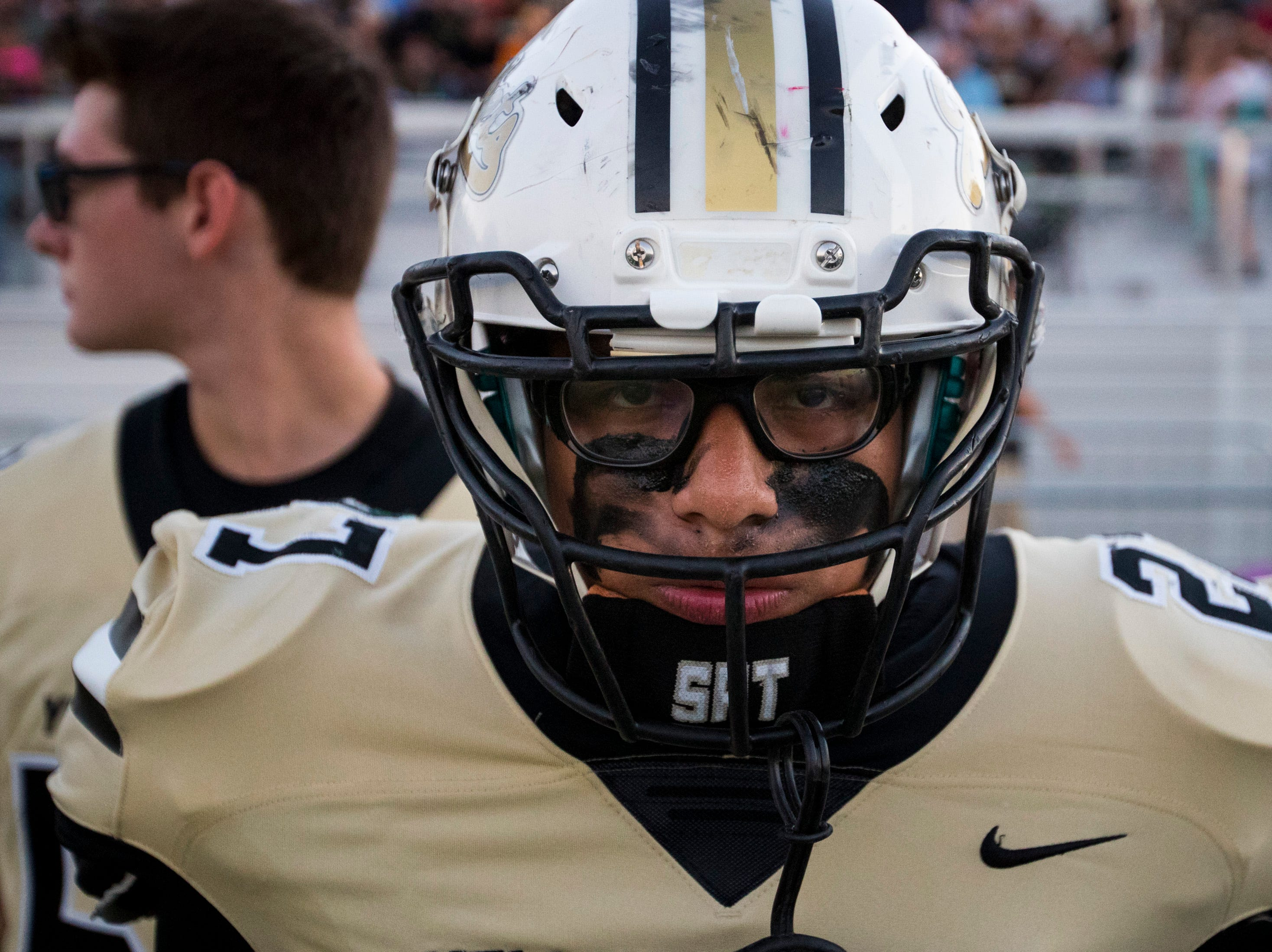 Springfield's Yonel Rodriguez (27) stares at the opposing sideline before Springfield's game against White House at Springfield High School in Springfield on Friday, Sept. 14, 2018.