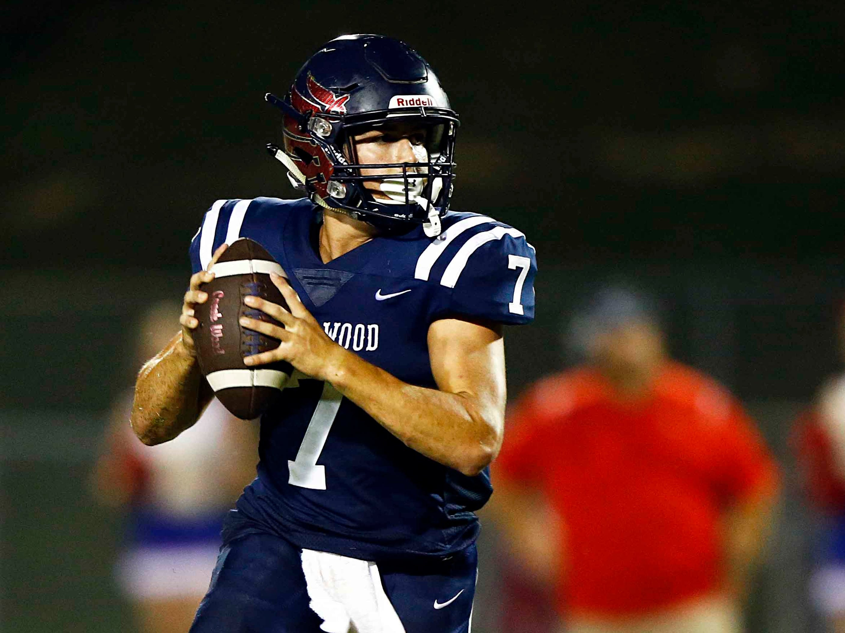 Creek Wood's Mitch Duke rolls out to pass during their game against Montgomery Central Friday, Sept. 14, 2018, in Charlotte, Tenn.