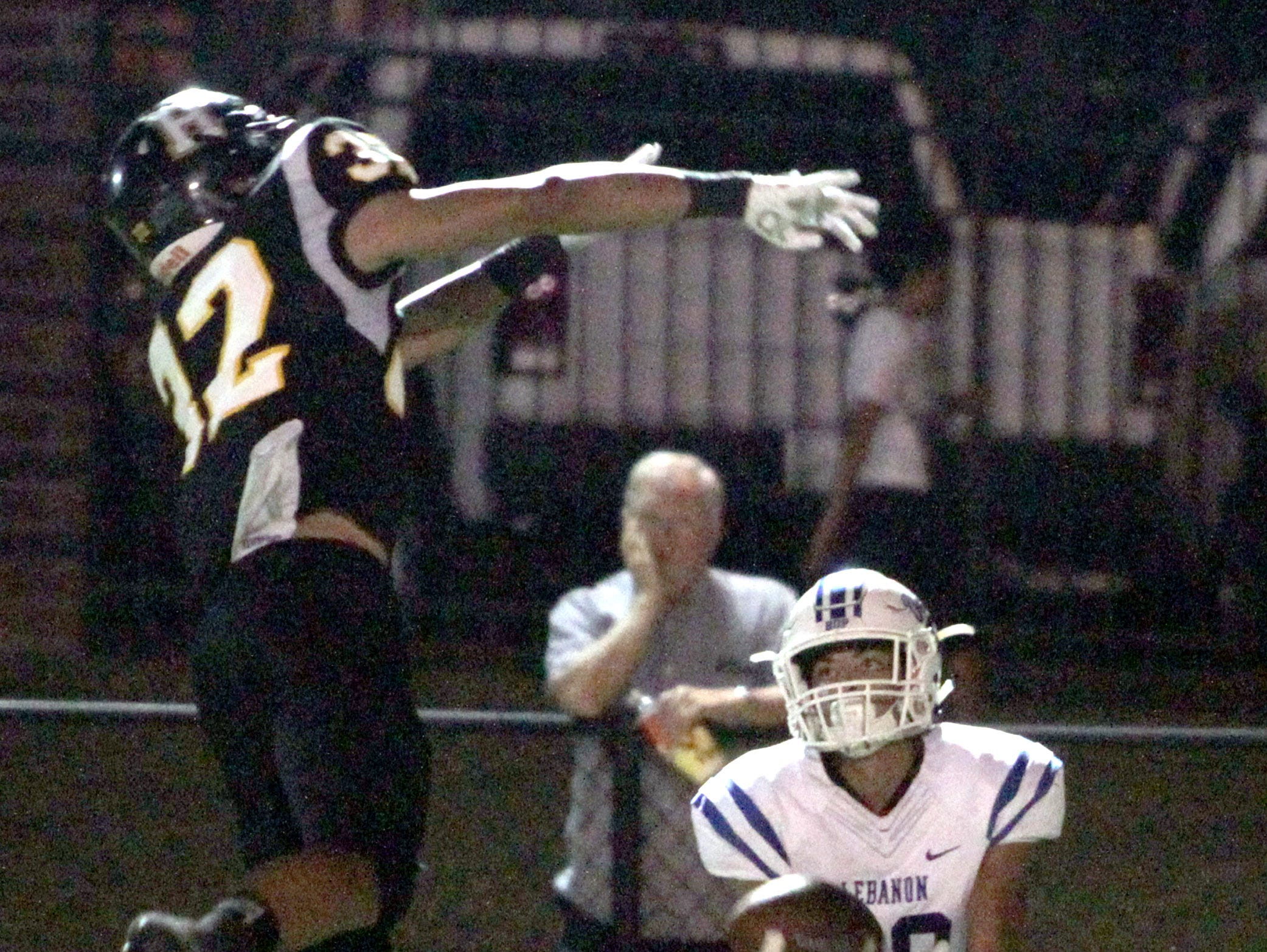 Hendersonville's Derek Kincaid swats the ball and Lebanon's Jackson Stafford almost catches the deflection on Friday, September 14, 2018.