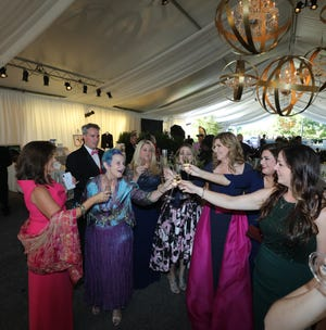 Wendy Dunavant, from left, Sean Sawyer, Emily Magid, Meredith McKellar-Rowley, Liz Hall, Jo Ellen McDowell, Bari Watson Beasley and Miriam Wiggins make a toast. The Heritage Foundation hosted the 45th Annual Heritage Ball at Eastern Flank Battlefield Park in Franklin, Tennessee, on Saturday, Sept. 15, 2018.