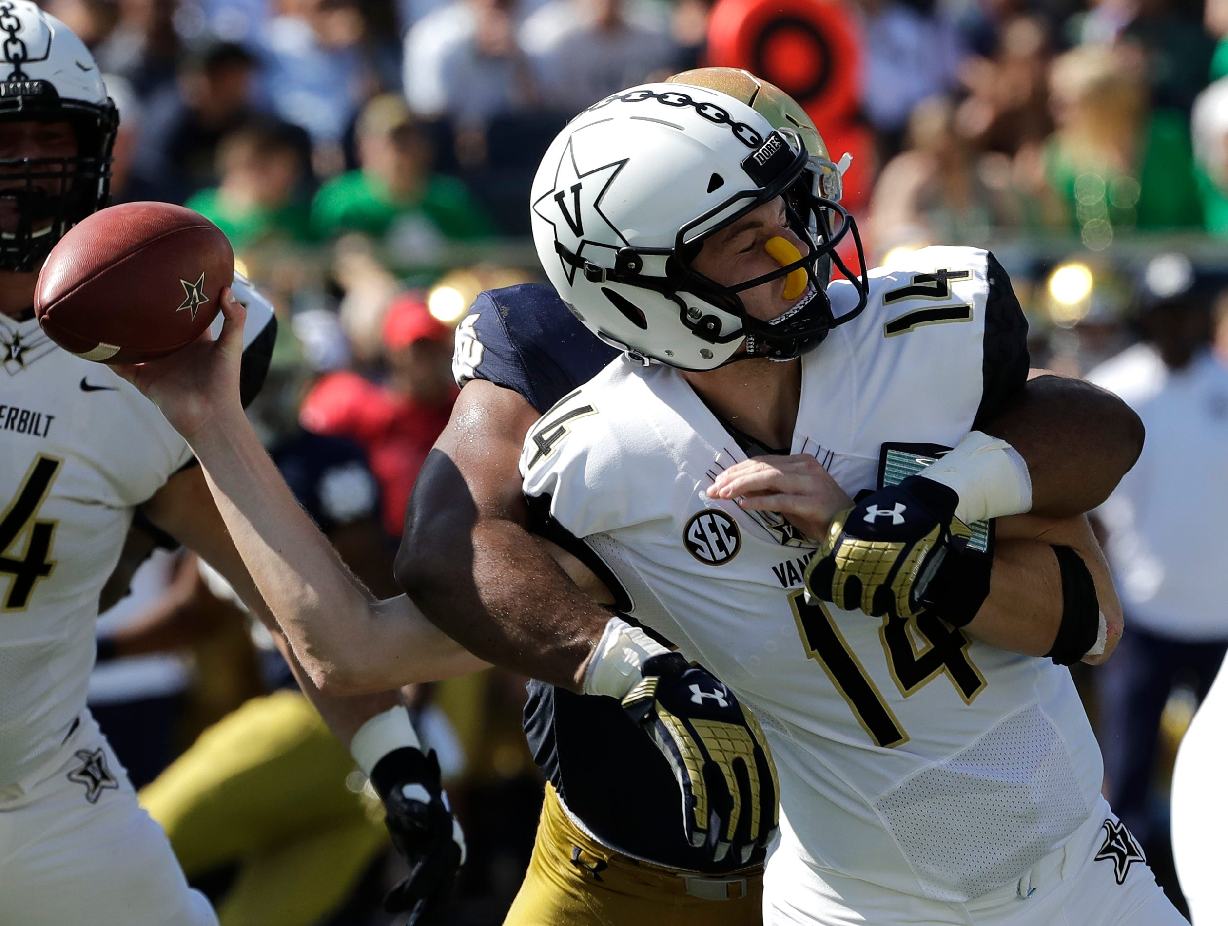 Vanderbilt quarterback Kyle Shurmur (14) is sacked by Notre Dame defensive line Jerry Tilery during the first half of an NCAA college football game in South Bend, Ind., Saturday, Sept. 15, 2018. (AP Photo/Nam Y. Huh)