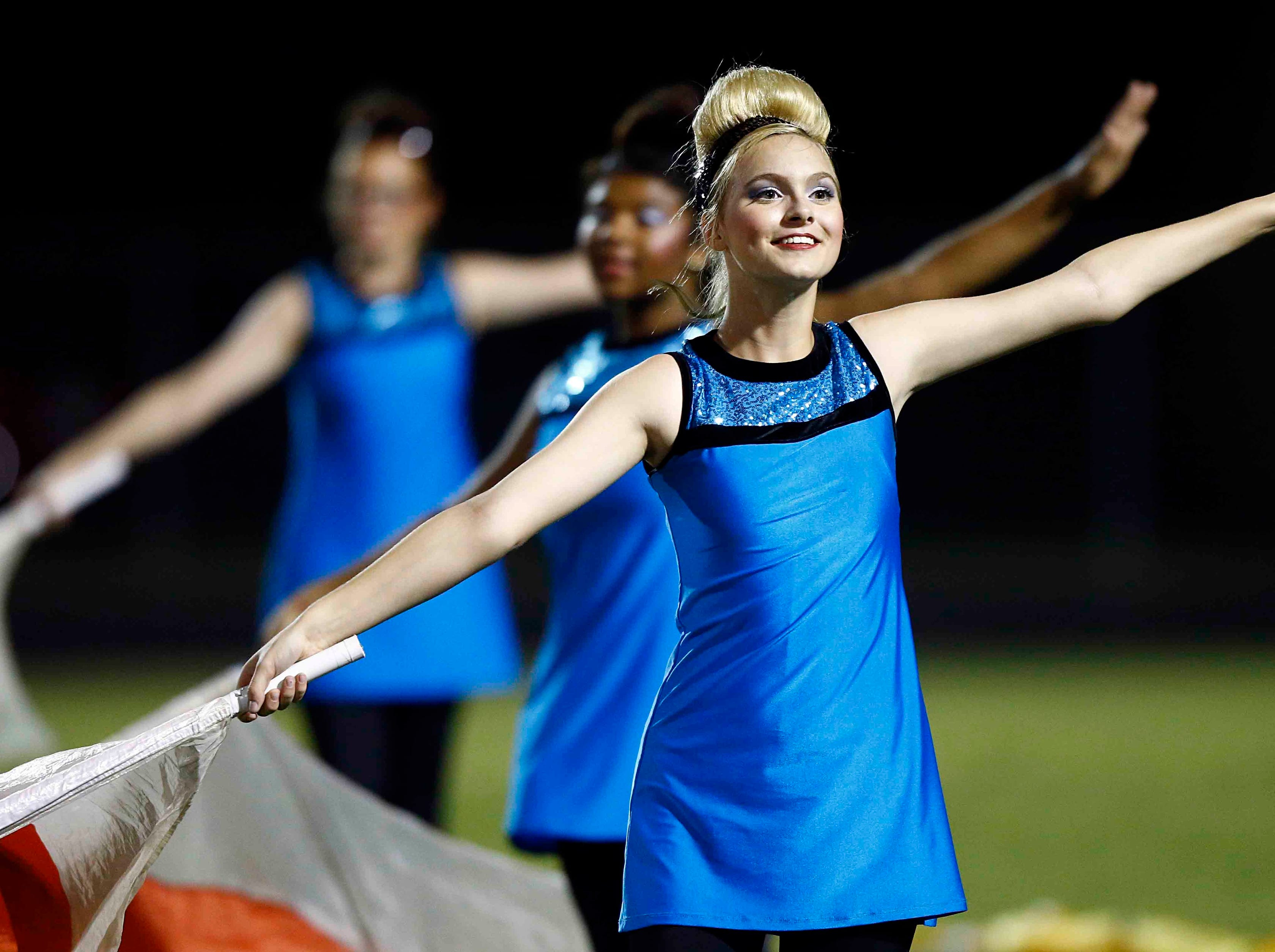 Members of the Creek Wood flag corp perform during halftime of their game against Montgomery Central Friday, Sept. 14, 2018, in Charlotte, Tenn.