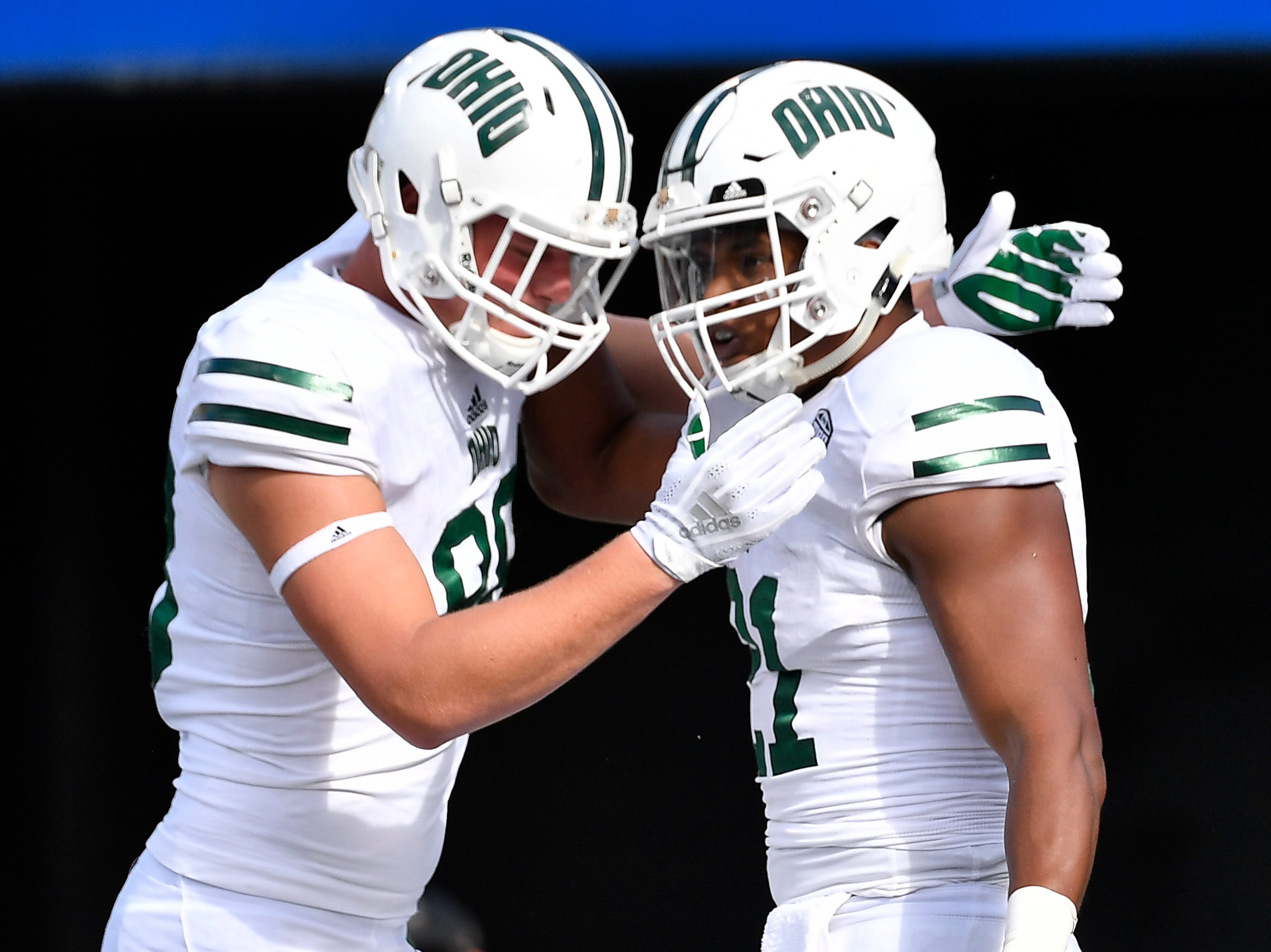 Ohio tight end Ryan Luehrman (88) congratulates running back Maleek Irons (21) after his touchdown against Virginia at Vanderbilt Stadium Saturday, Sept. 15, 2018, in Nashville, Tenn.