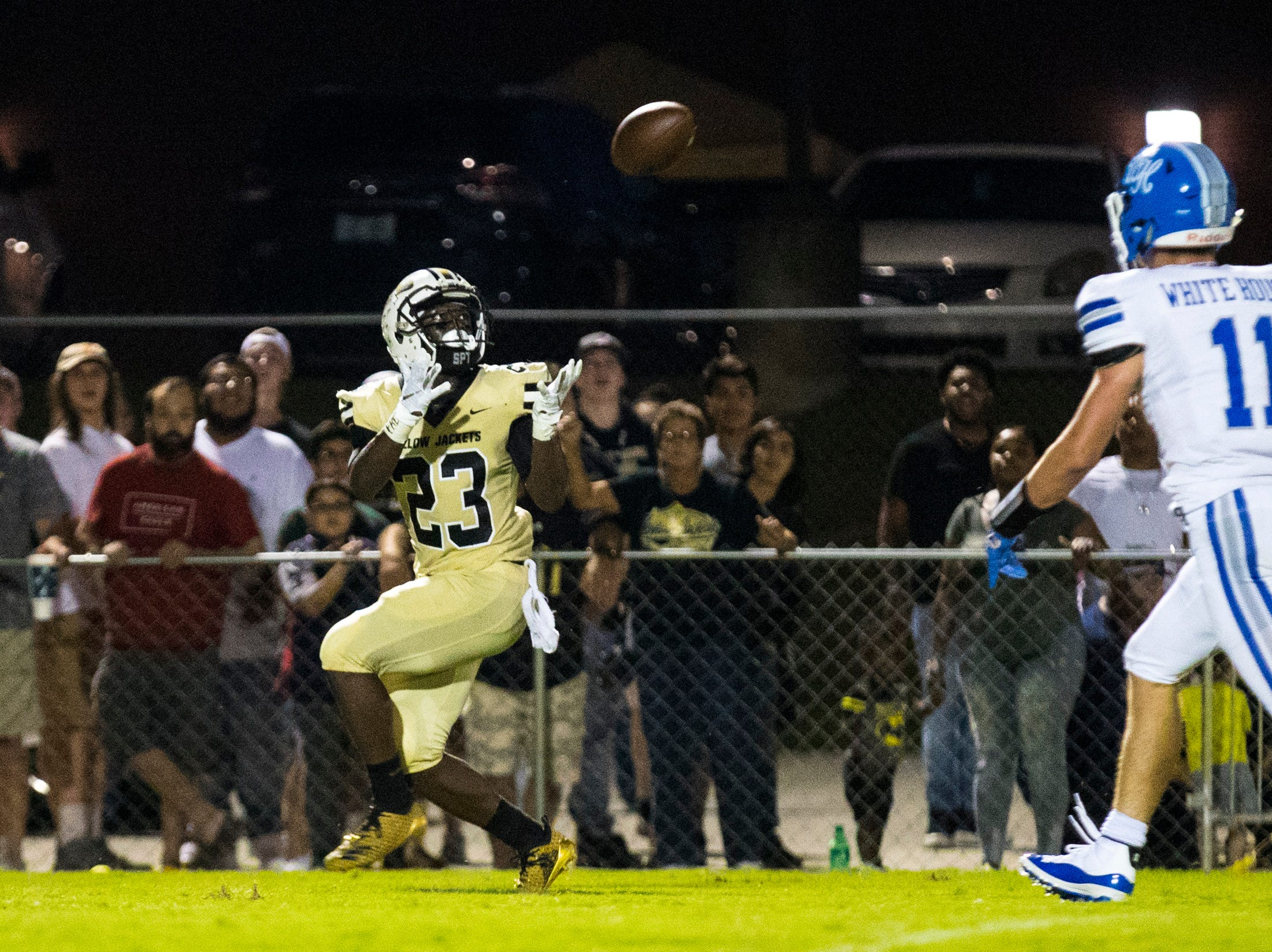 Springfield's Dayron Johnson (23) catches a long ball during Springfield's game against White House at Springfield High School in Springfield on Friday, Sept. 14, 2018.