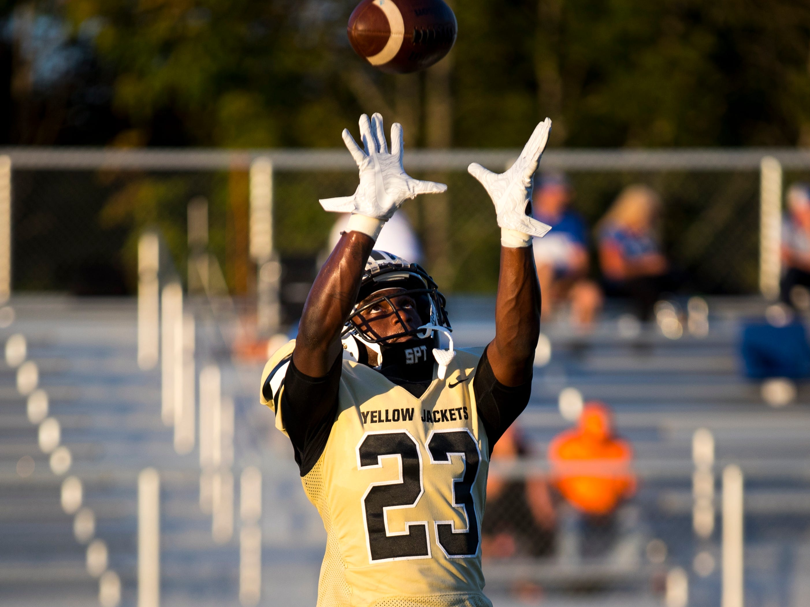 Springfield's Dayron Johnson (23) catches a pass during warmups before Springfield's game against White House at Springfield High School in Springfield on Friday, Sept. 14, 2018.