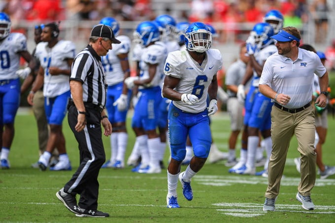 Sep 15, 2018; Athens, GA, USA; Middle Tennessee Blue Raiders linebacker Khalil Brooks (6) leaves the field after hitting Georgia Bulldogs quarterback Justin Fields (1) (not shown) with his helmet resulting in a targeting penalty during the first half at Sanford Stadium. Mandatory Credit: Dale Zanine-USA TODAY Sports