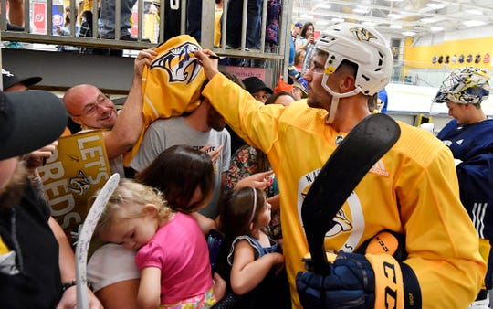 Predators' Roman Josi signs an autograph for a fan at Centennial Sportsplex Saturday, Sept. 15, 2018, in Nashville, Tenn.
