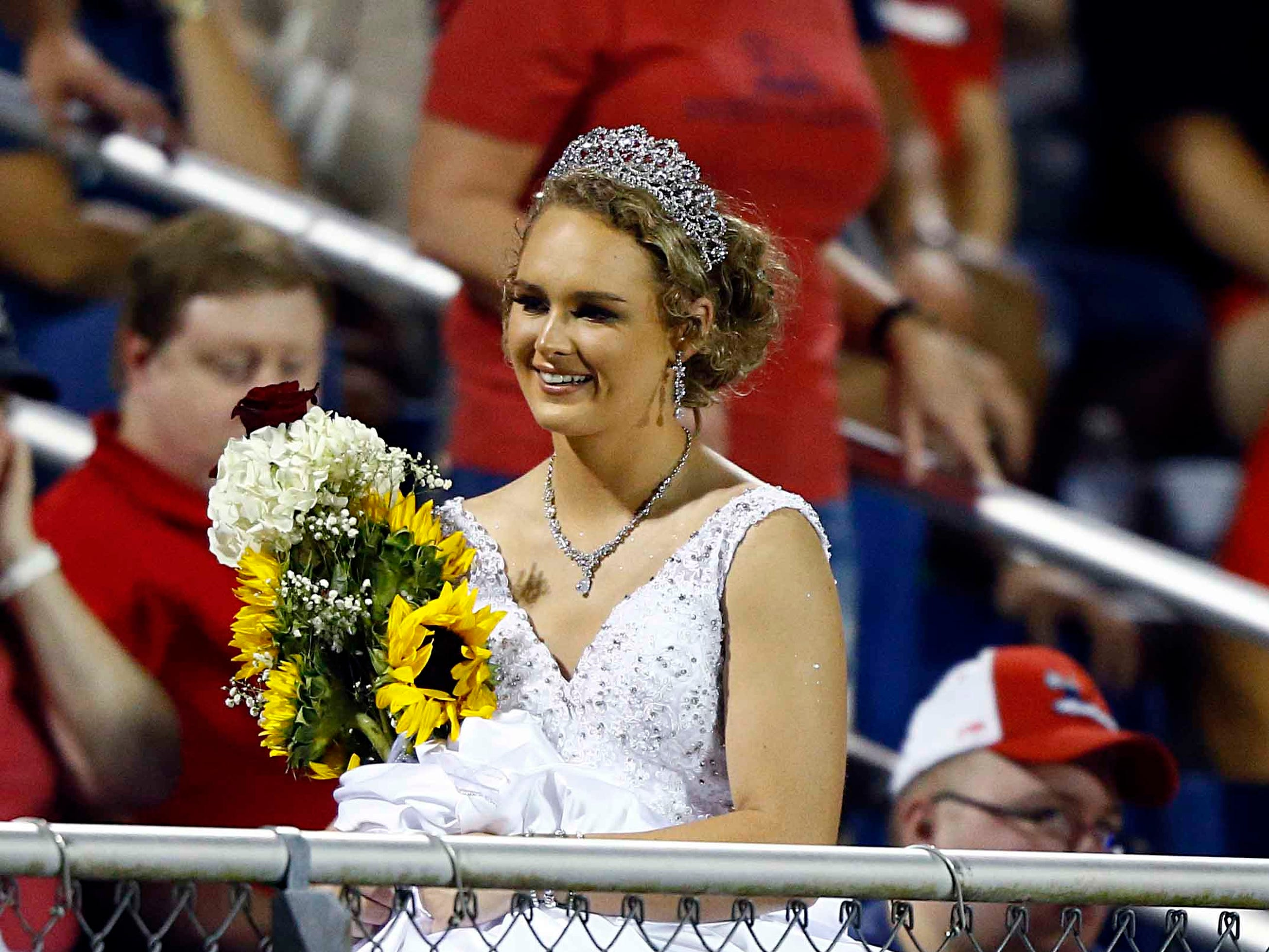 Creek Wood Homecoming Queen, Analee Coursey makes her way past fans the game against Montgomery Central Friday, Sept. 14, 2018, in Charlotte, Tenn.