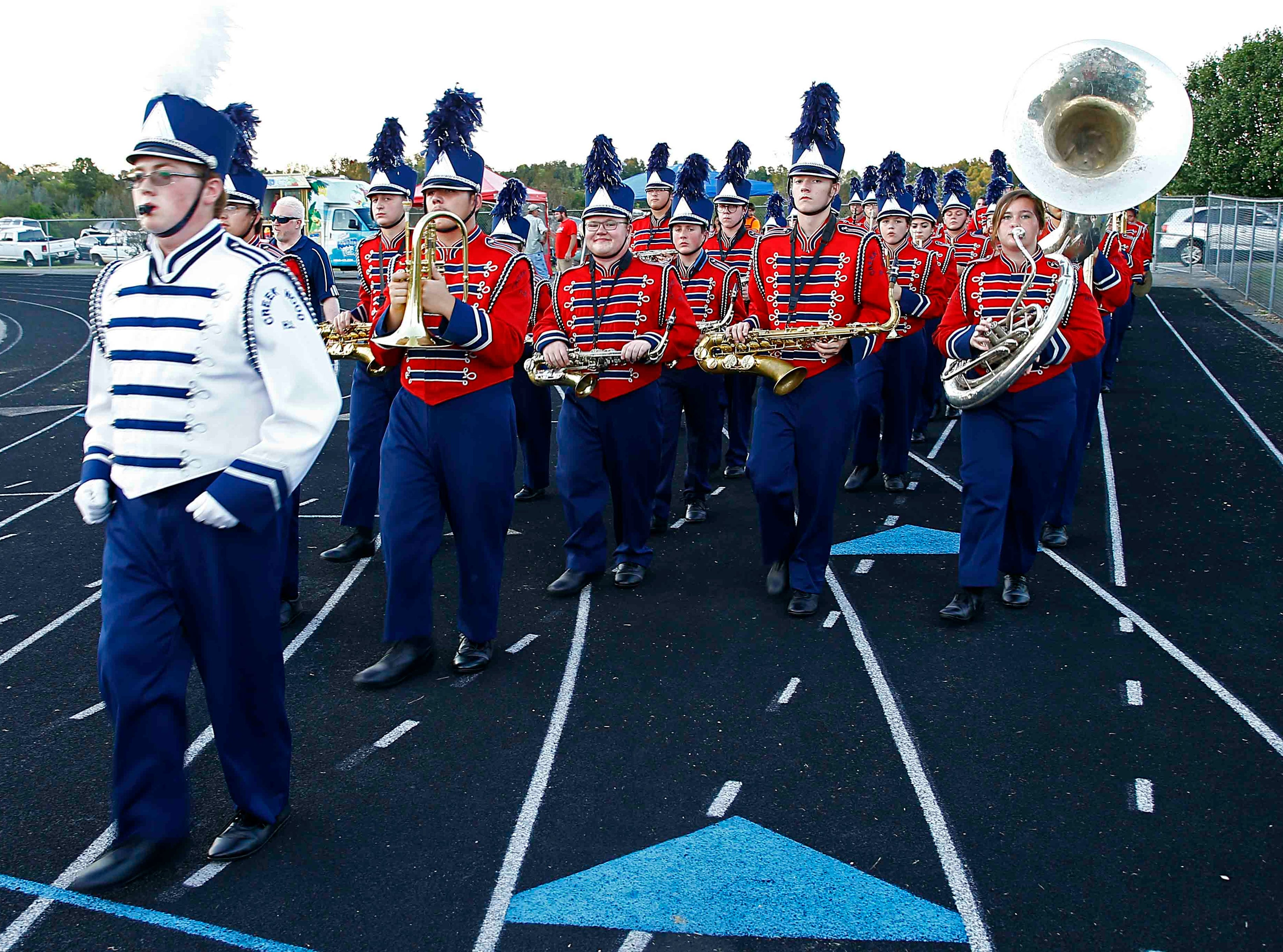 The Creek Wood band enters the field before the game against Montgomery Central during the game Friday, Sept. 14, 2018, in Charlotte, Tenn.