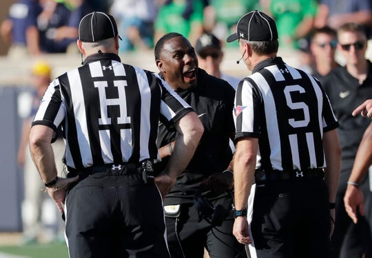 Vanderbilt head coach Derek Mason, center, argues a call with the referees during the second half against Notre Dame in South Bend, Ind., Saturday, Sept. 15, 2018.