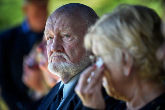 Jim DeMoss, sits stoically next to his daughter Judy Ivey and family as his brother Harold DeMoss is buried at the DeMoss Family Cemetery in Nashville, Tenn., Saturday, Sept. 15, 2018.