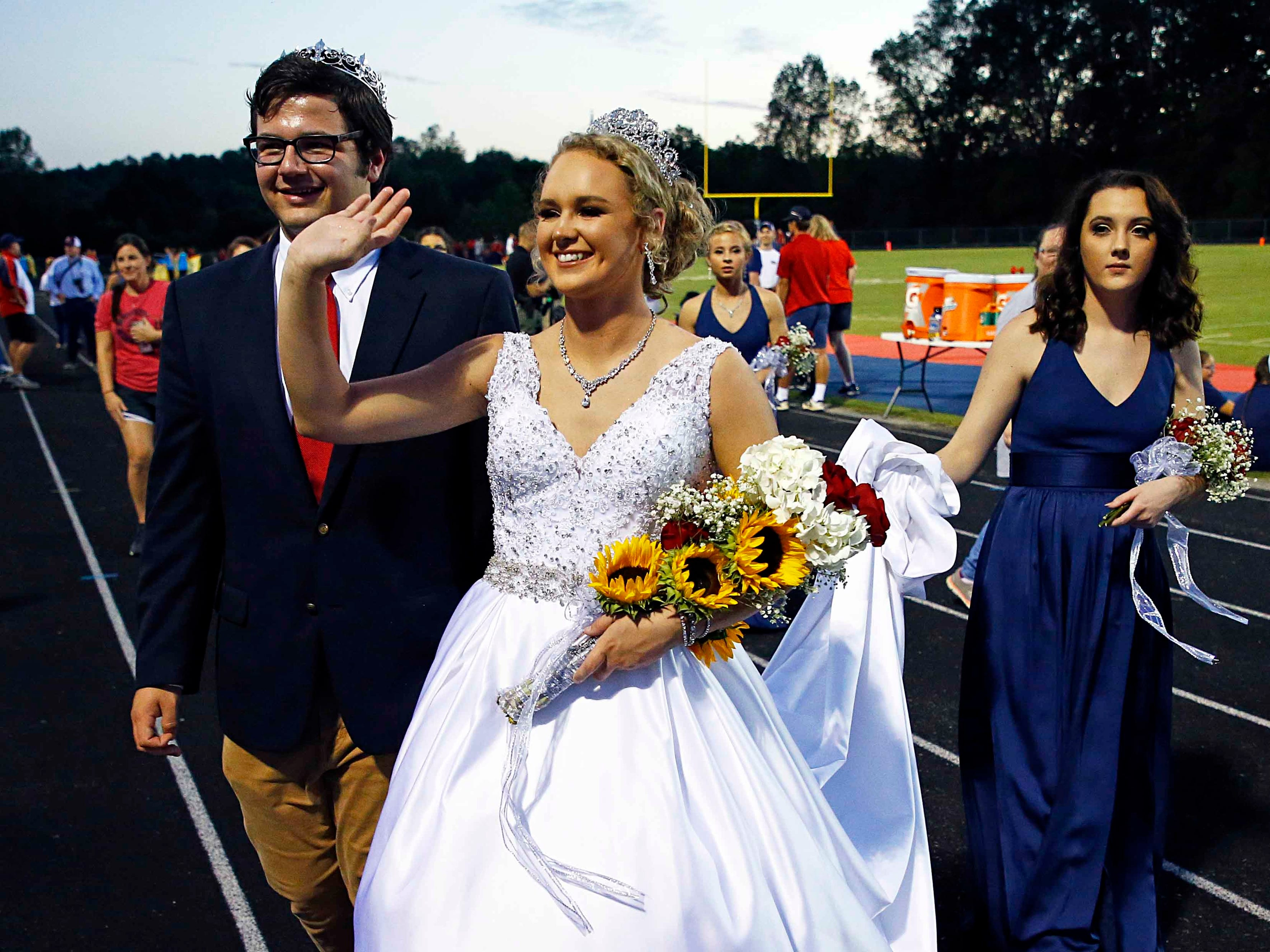 Creek Wood Homecoming Queen Analee Coursey and Homecoming King  John Mark Faught are seen after being introduced before the game against Montgomery Central Friday, Sept. 14, 2018, in Charlotte, Tenn.