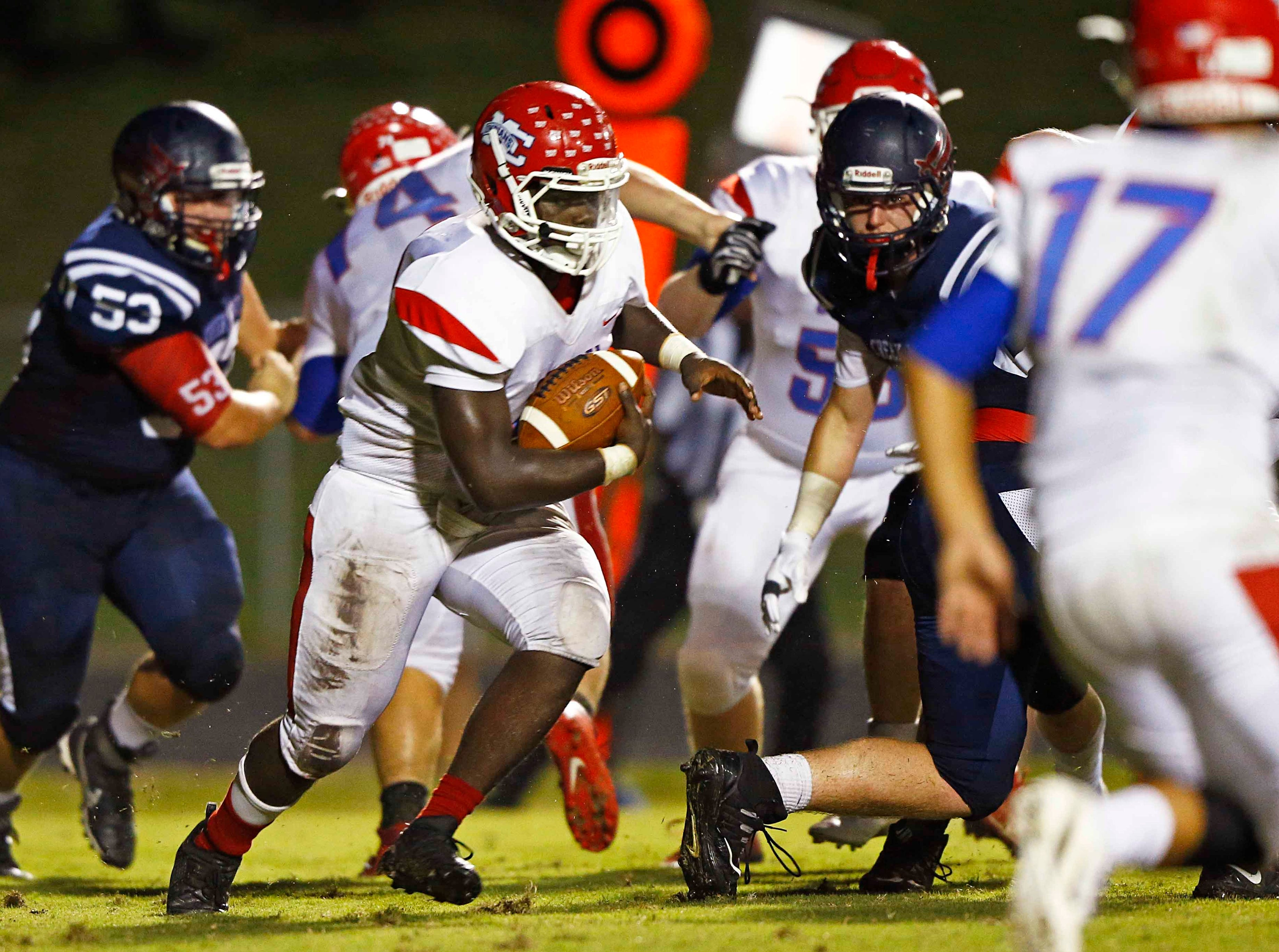 Montgomery Central's Lakendriez Sanders runs for yardage during the game against Creek Wood Friday, Sept. 14, 2018, in Charlotte, Tenn.