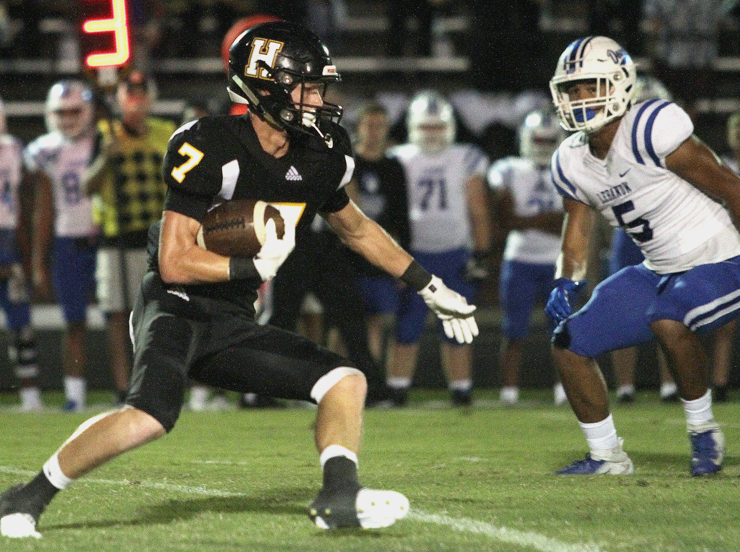 Hendersonville's Logan Spurrier rushes against Lebanon on Friday, September 14, 2018.