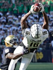 Notre Dame safety Jalen Elliott, left, breaks up a fourth-down pass to Vanderbilt wide receiver Kalija Lipscomb in the final minutes on Sept. 15, 2018. Notre Dame won 22-17.