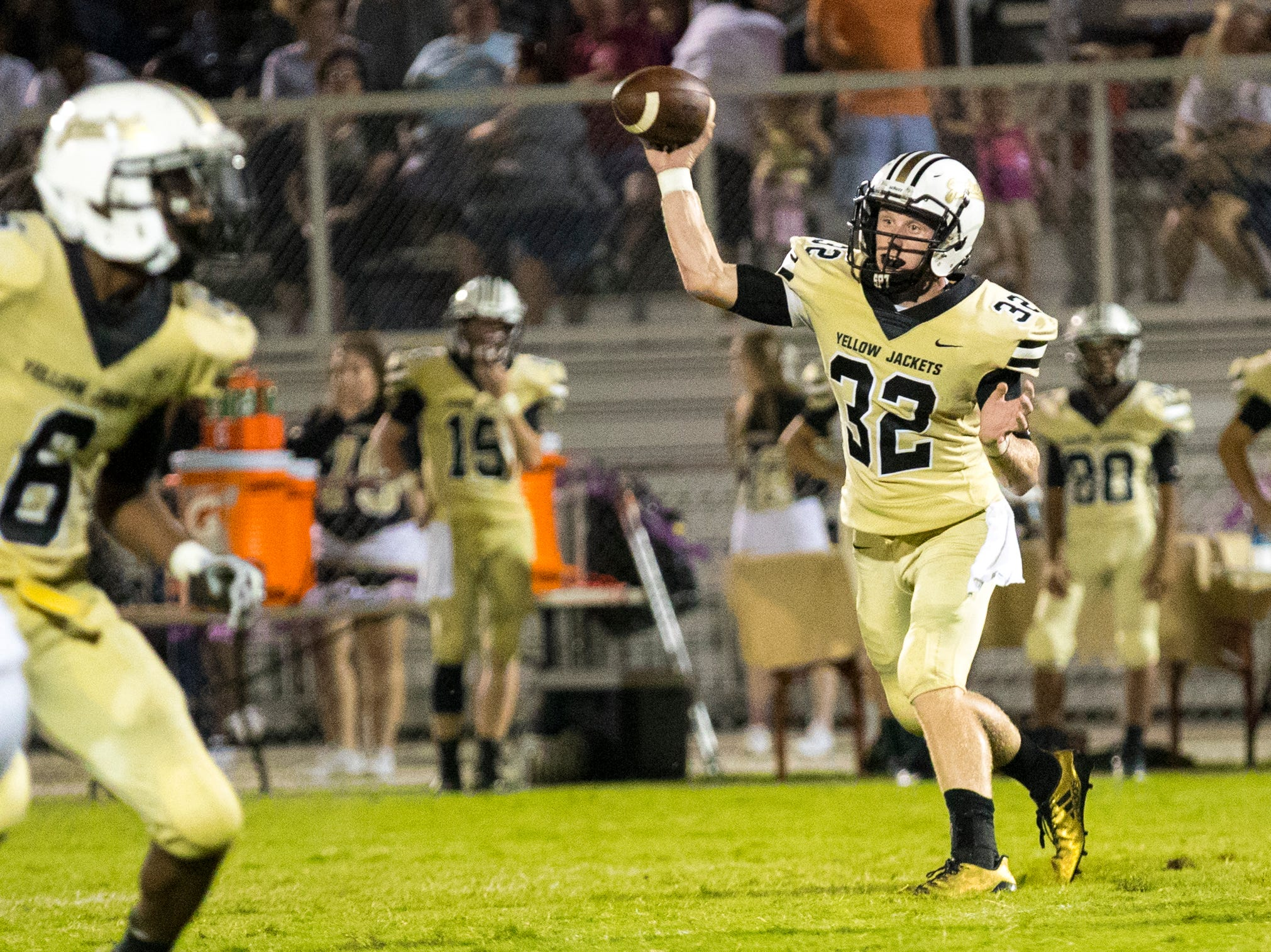 Springfield's Bryan Hayes (32) passes during Springfield's game against White House at Springfield High School in Springfield on Friday, Sept. 14, 2018.