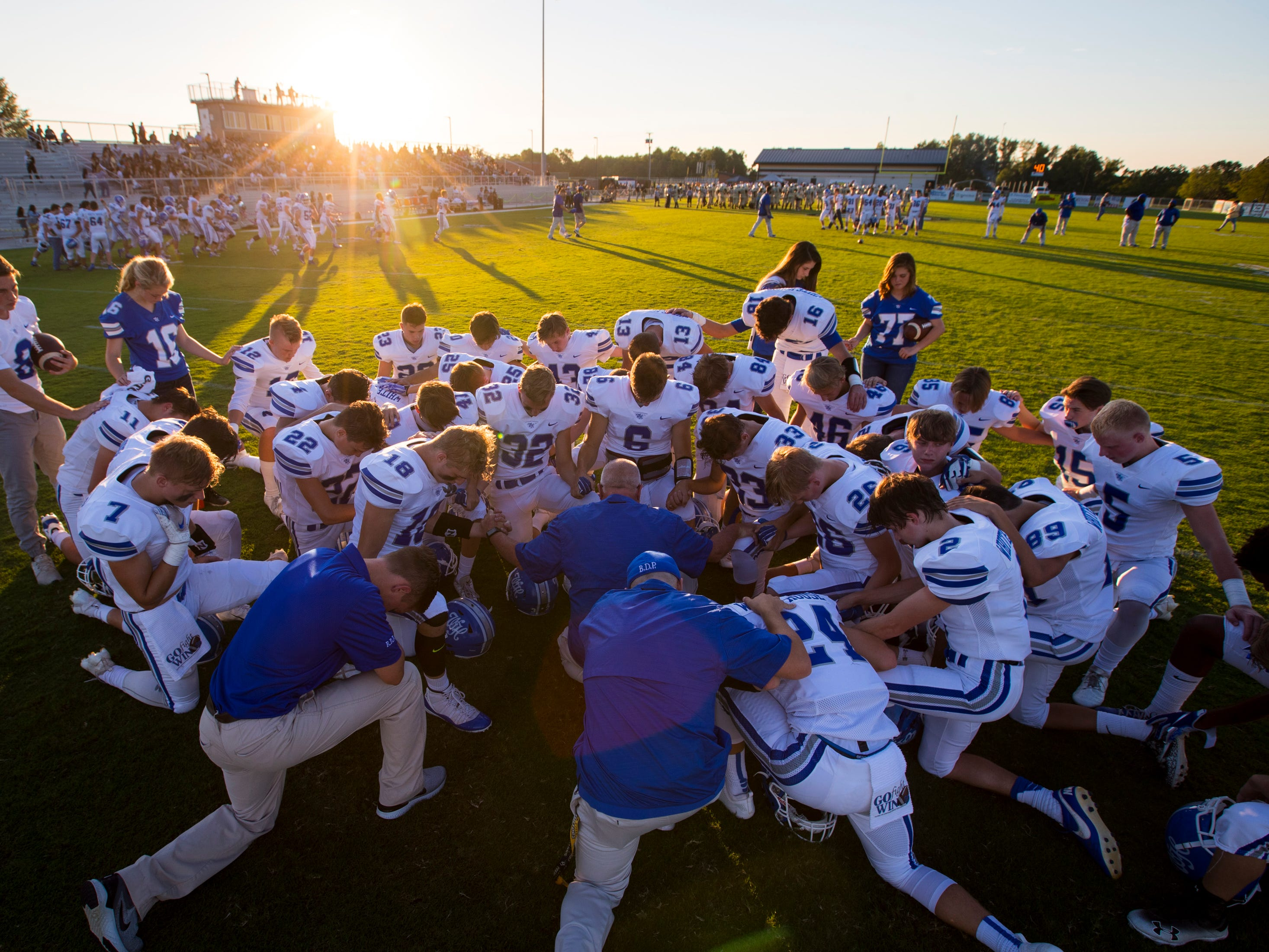 White House's players say a prayer before Springfield's game against White House at Springfield High School in Springfield on Friday, Sept. 14, 2018.