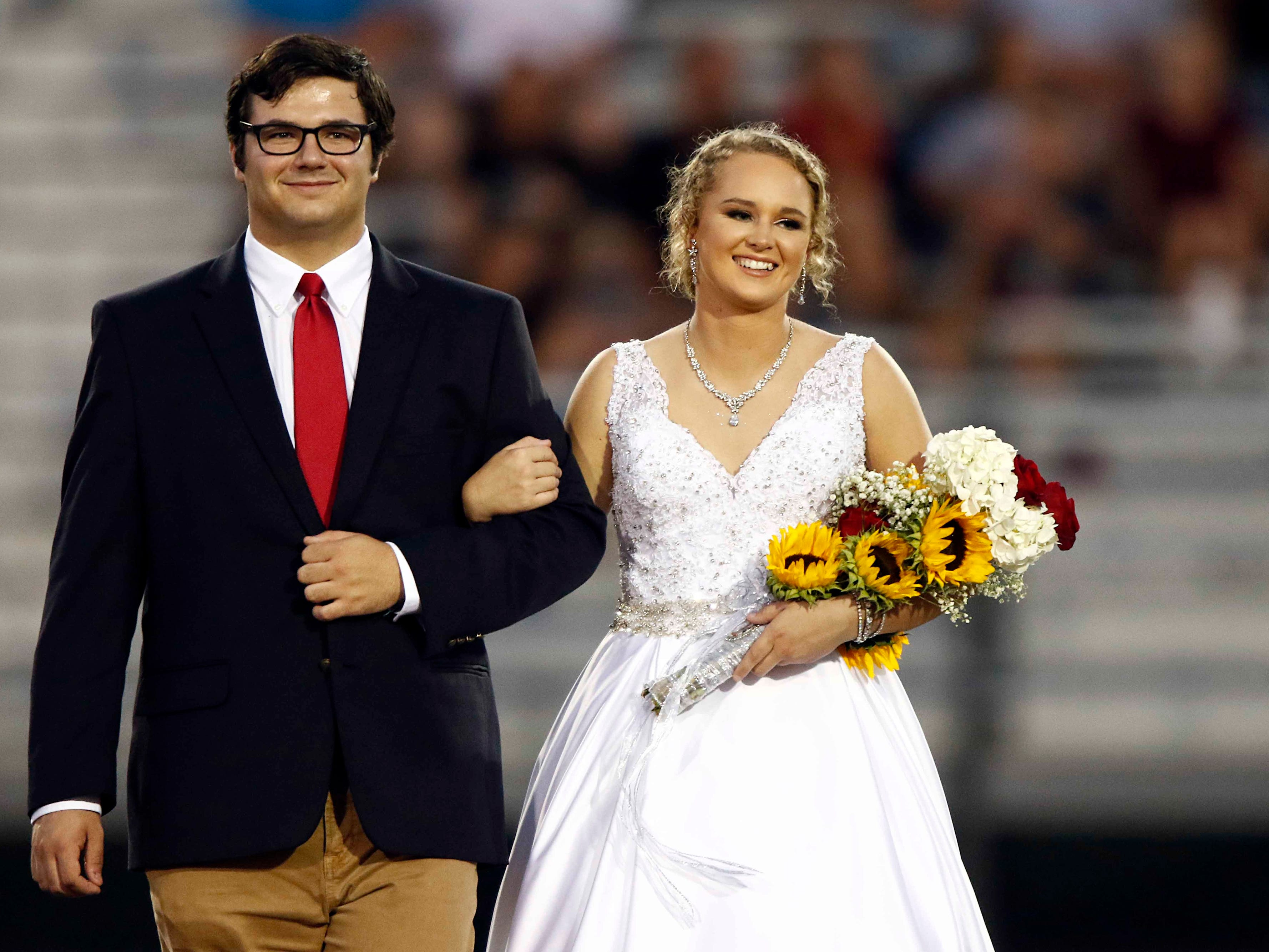 Creek Wood Homecoming Queen Analee Coursey and Homecoming King John Mark Faught are seen before the game against Montgomery Central Friday, Sept. 14, 2018, in Charlotte, Tenn.