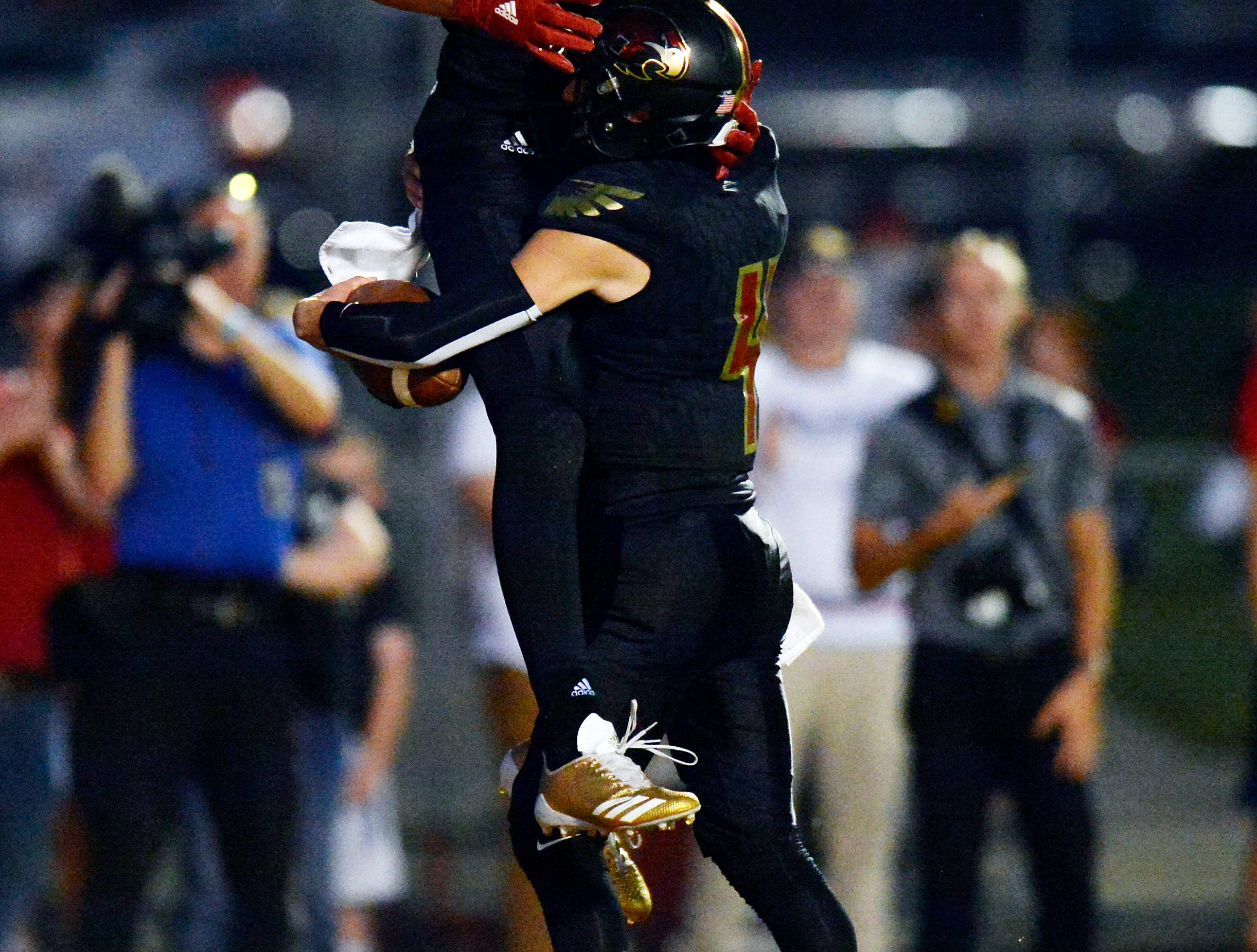 Ravenwood quarterback Brian Garcia (4) celebrates with Ravenwood tight end Jake Briningstool (9) after Garcia caught a pass for a touchdown against Brentwood during the first half of an high school football game Friday, September 14, 2018, in Brentwood, Tenn.