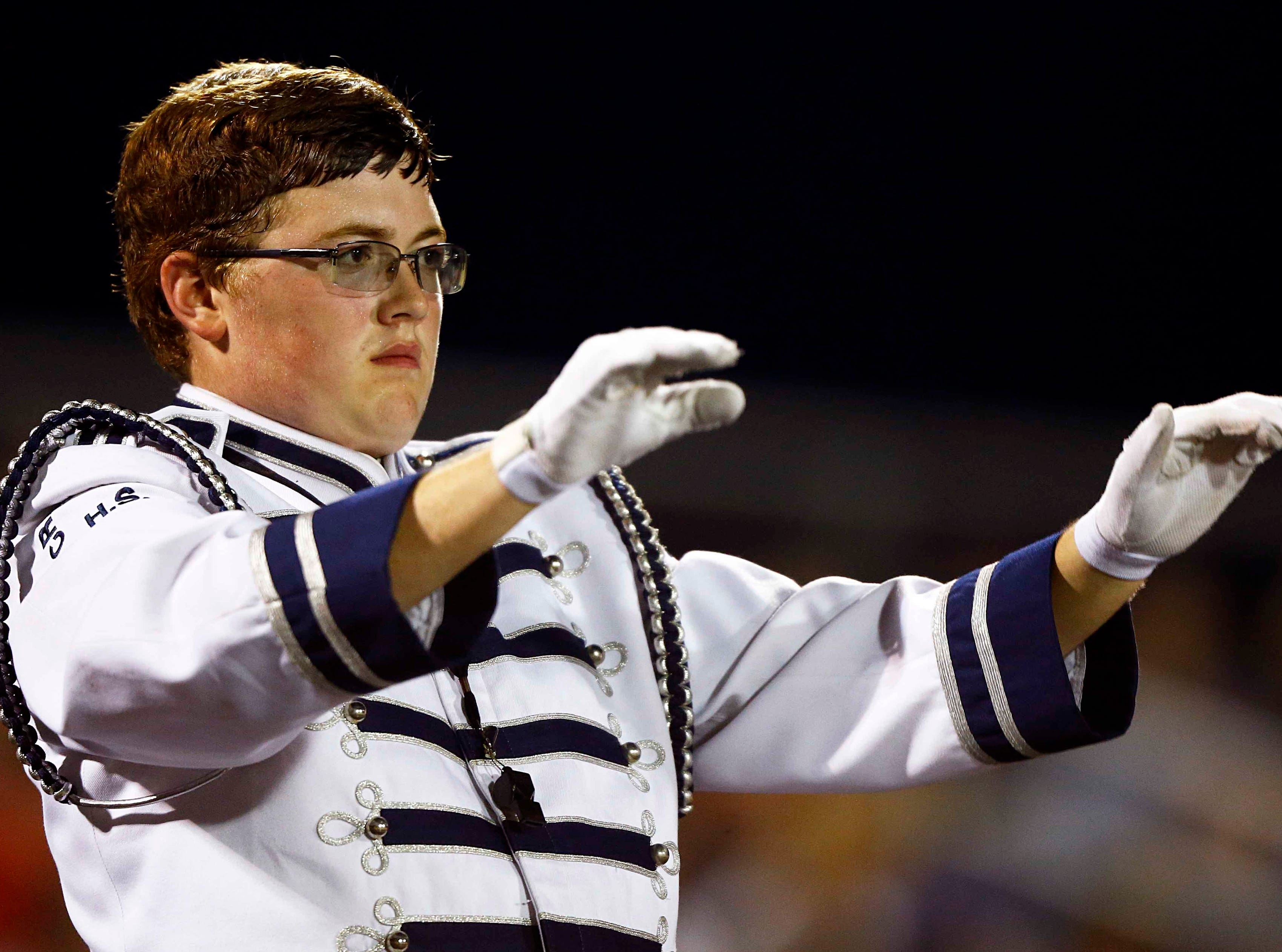 Creek Wood's drum major leads the band  during halftime of their game against Montgomery Central Friday, Sept. 14, 2018, in Charlotte, Tenn.