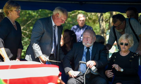 Jim DeMoss is surrounded by family at the funeral of  Harold DeMoss, a pilot who died during WWII, at the DeMoss Family Cemetery in Nashville, Tenn., Saturday, Sept. 15, 2018.