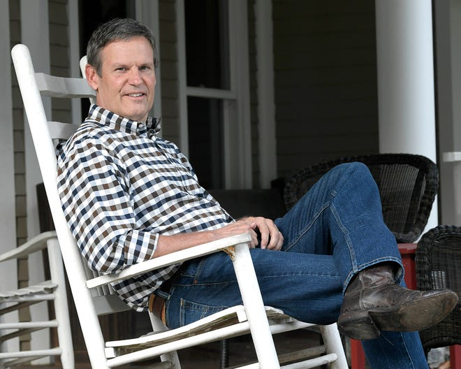 Bill Lee sits on his Williamson County front porch on Sept. 9. Tennessee's incoming Republican governor recently invited Democratic lawmakers for a dinner at his home.