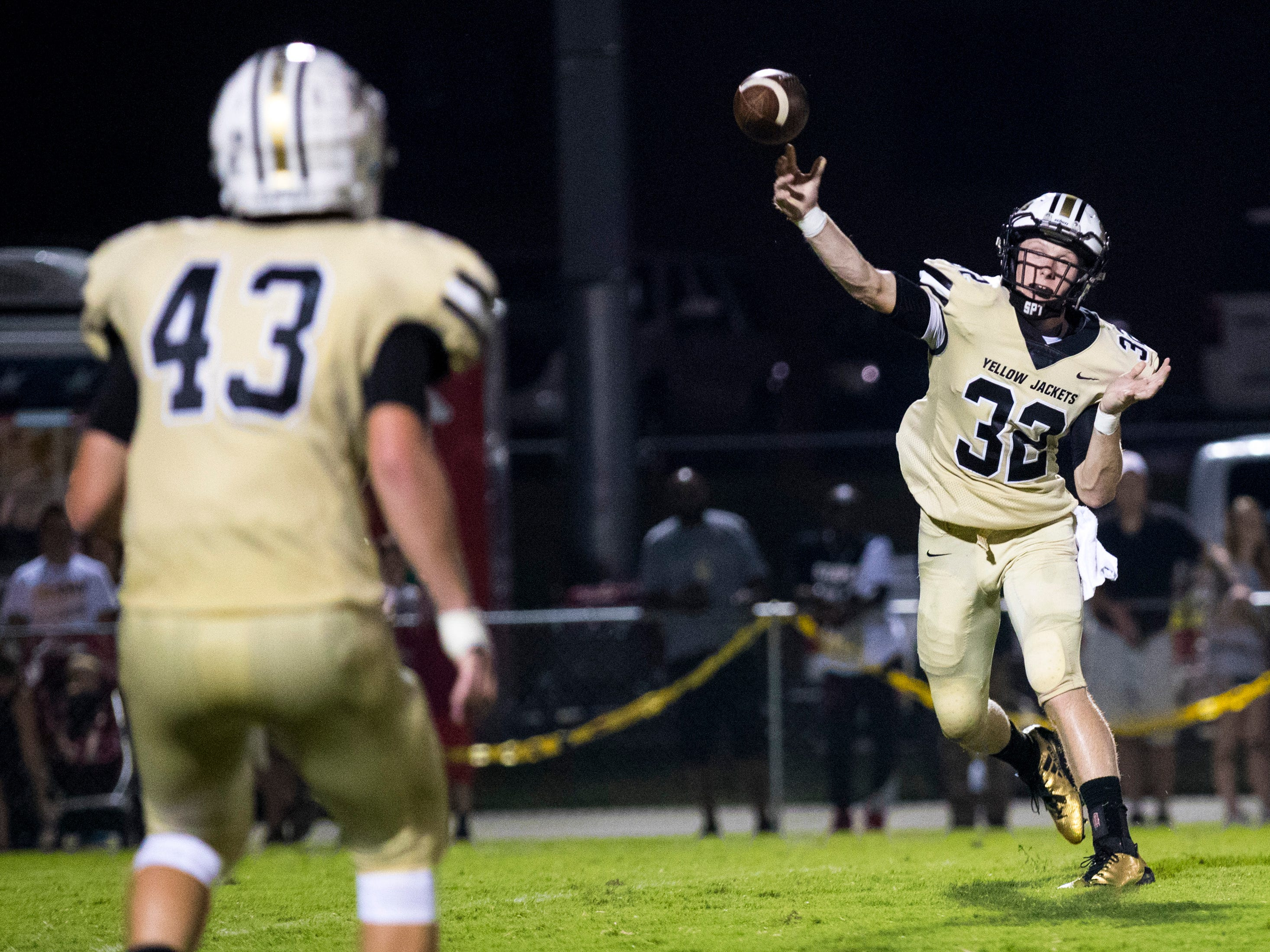 Springfield's Bryan Hayes (32) passes to Springfield's Mikie Neal (43) during Springfield's game against White House at Springfield High School in Springfield on Friday, Sept. 14, 2018.