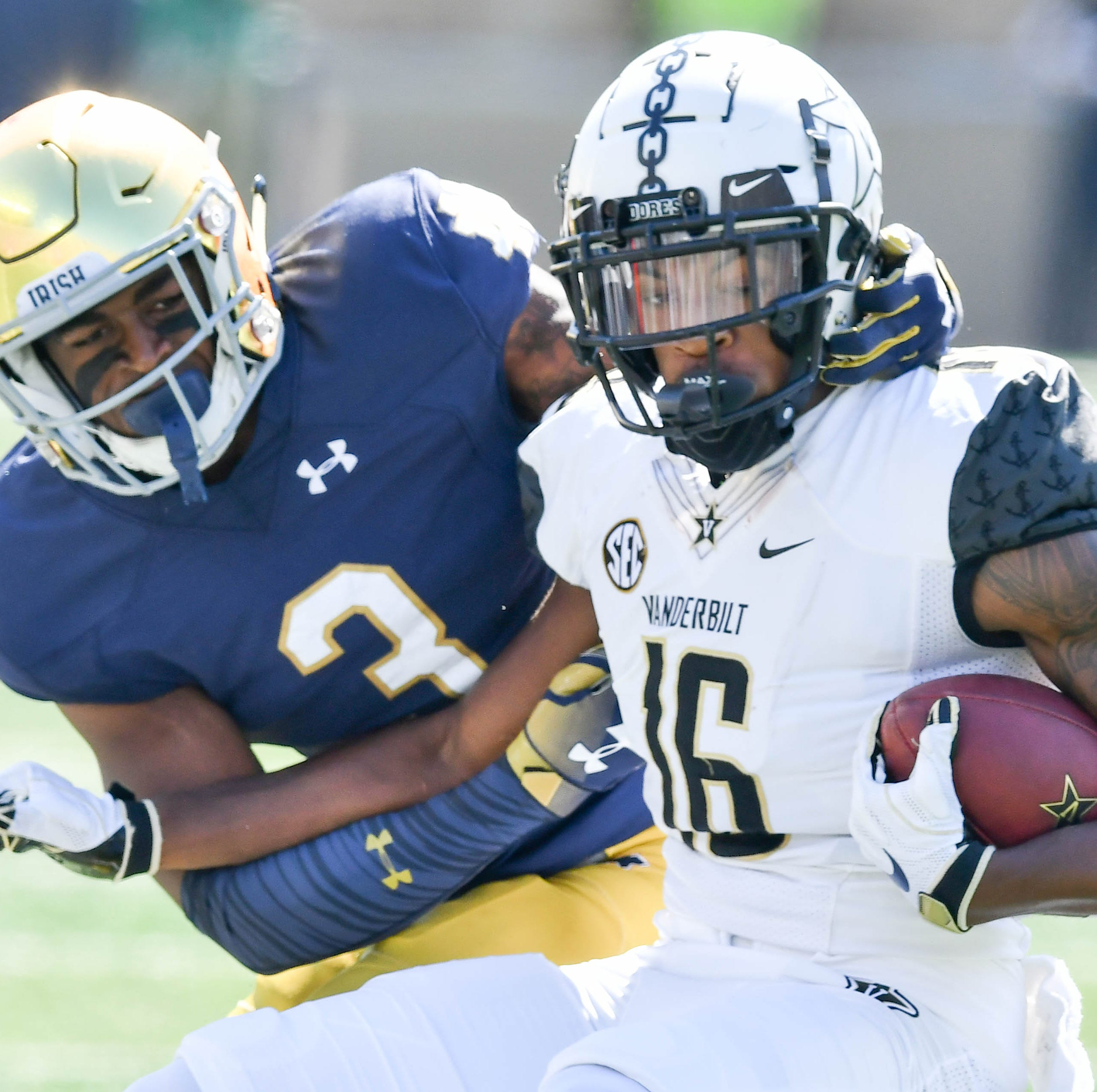 Sep 15, 2018; South Bend, IN, USA; Vanderbilt Commodores wide receiver Kalija Lipscomb (16) is tackled by Notre Dame Fighting Irish defensive back Houstson Griffith (3) in the first quarter at Notre Dame Stadium. Mandatory Credit: Matt Cashore-USA TODAY Sports