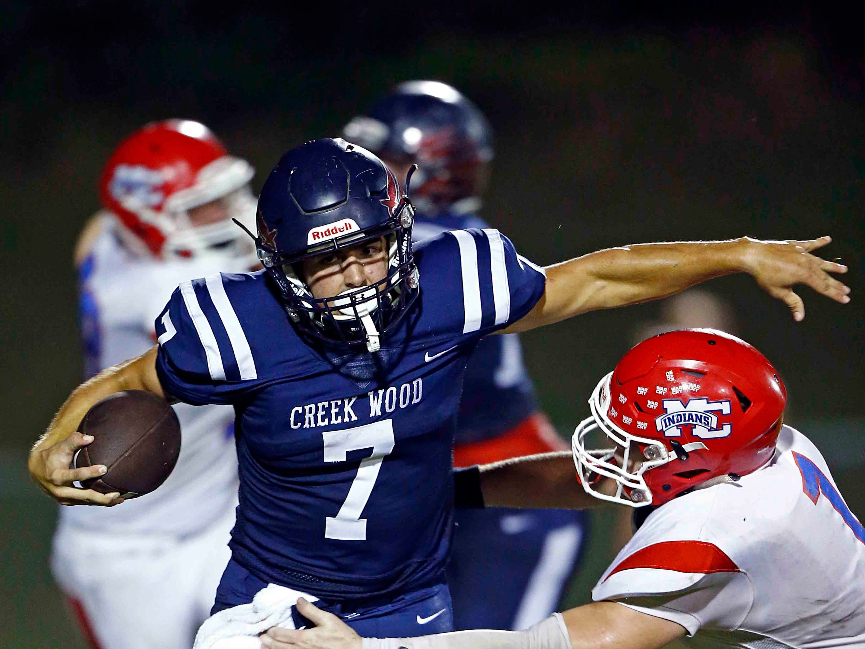 Creek Wood's Mitch Duke (7) is tackled by Montgomery Central's Dylan Williams (1) during their game Friday, Sept. 14, 2018, in Charlotte, Tenn.