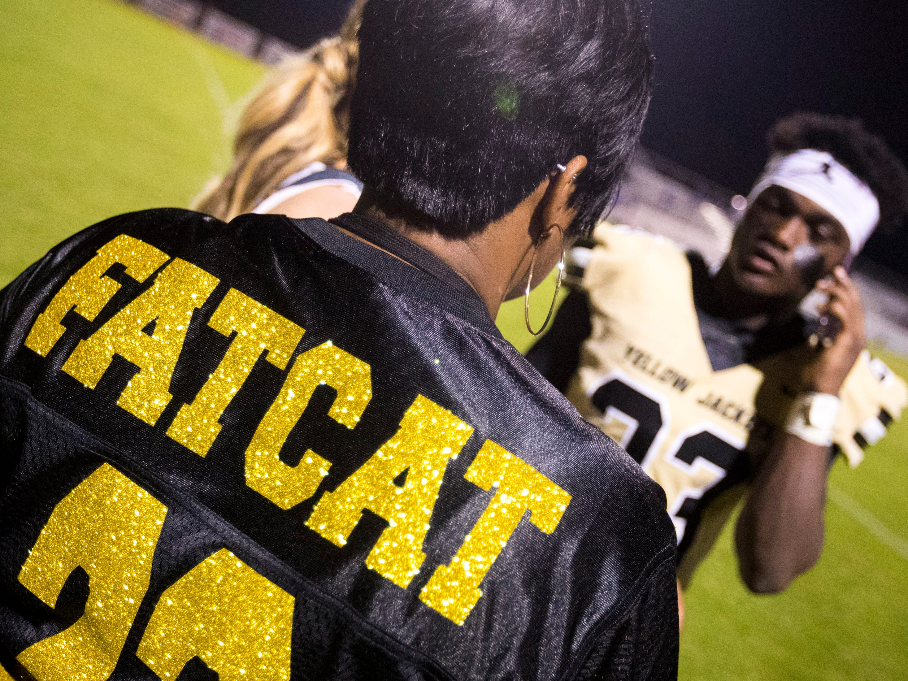 "Sharon West wears a jersey with her son Springfield's Dayron Johnson's (23) nickname ""Fatcat"" on it after Springfield's game against White House at Springfield High School in Springfield on Friday, Sept. 14, 2018."