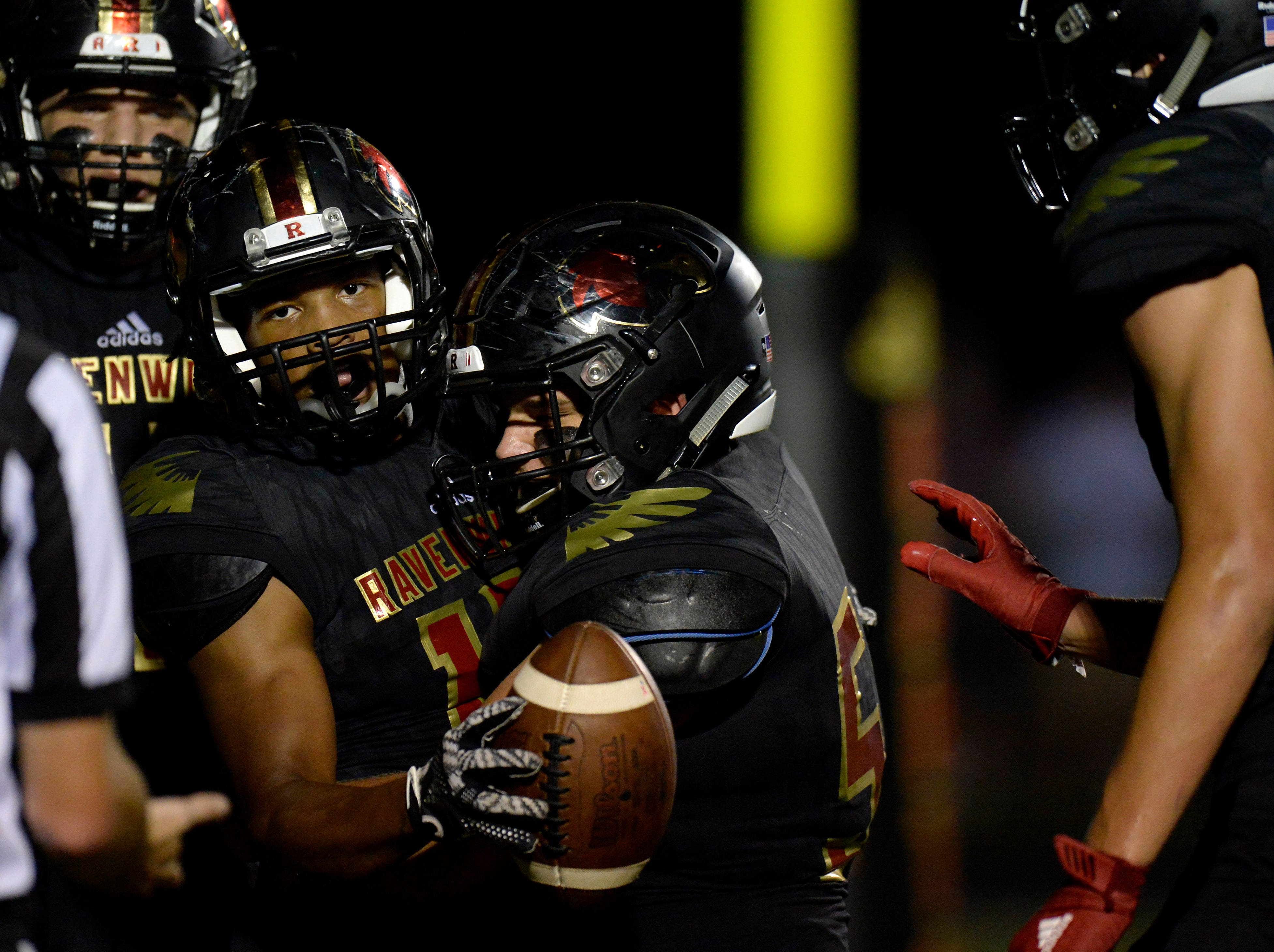 Ravenwood running back Tony Rice, left, celebrates with teammates after scoring a touchdown against Brentwood during the first half of an high school football game Friday, September 14, 2018, in Brentwood, Tenn.