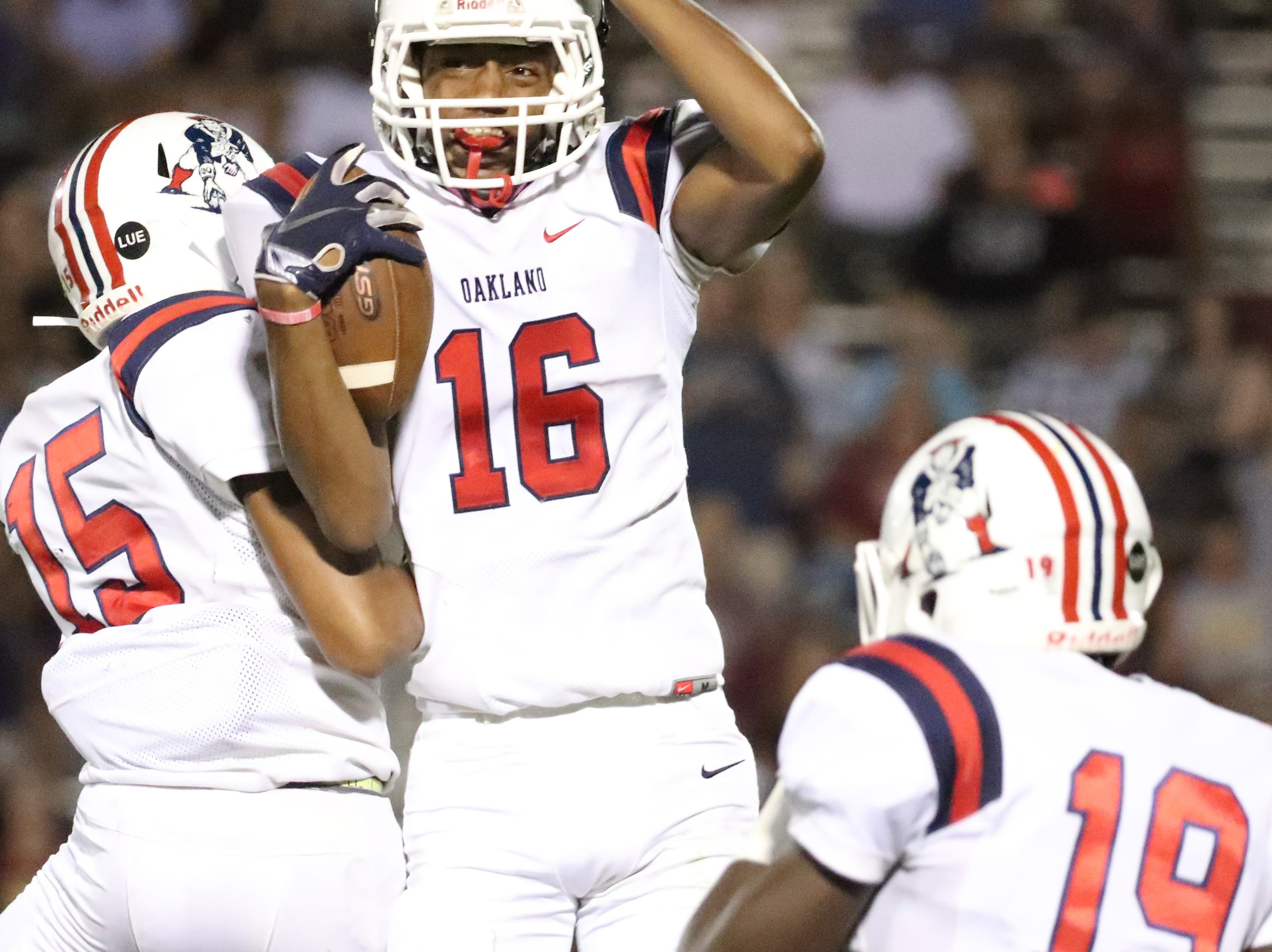 Oakland's DeDe Anderson(16) celebrates his interception against Oakland with Kobe Manning (15) at Riverdale during the Battle of the Boro on Friday, Sept. 14, 2018.