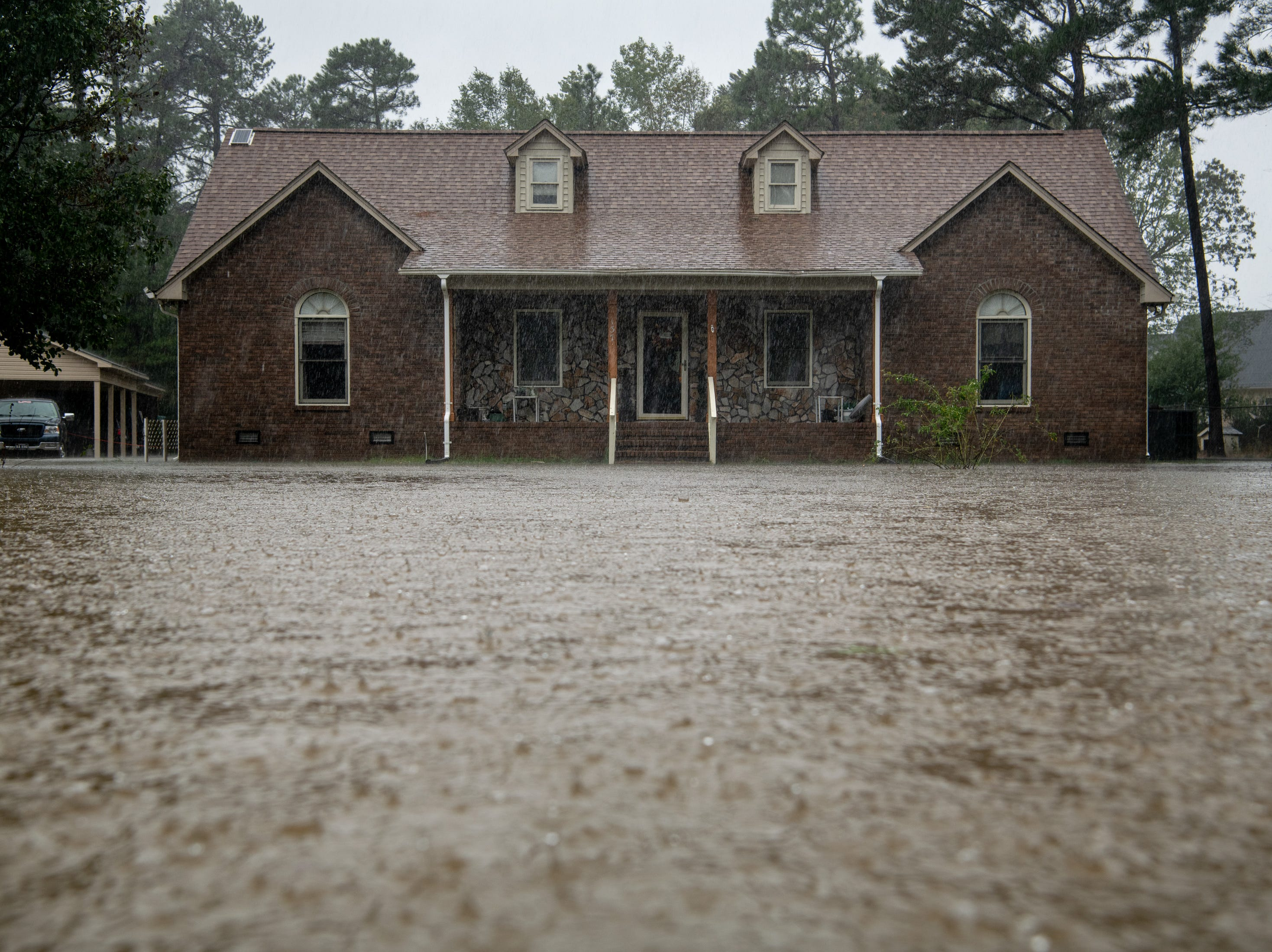 Flood water reaches the home of William and Mittie Wooten as rain from Tropical Storm Florence continues to fall on Lumberton, N.C., Saturday, Sept. 15, 2018.
